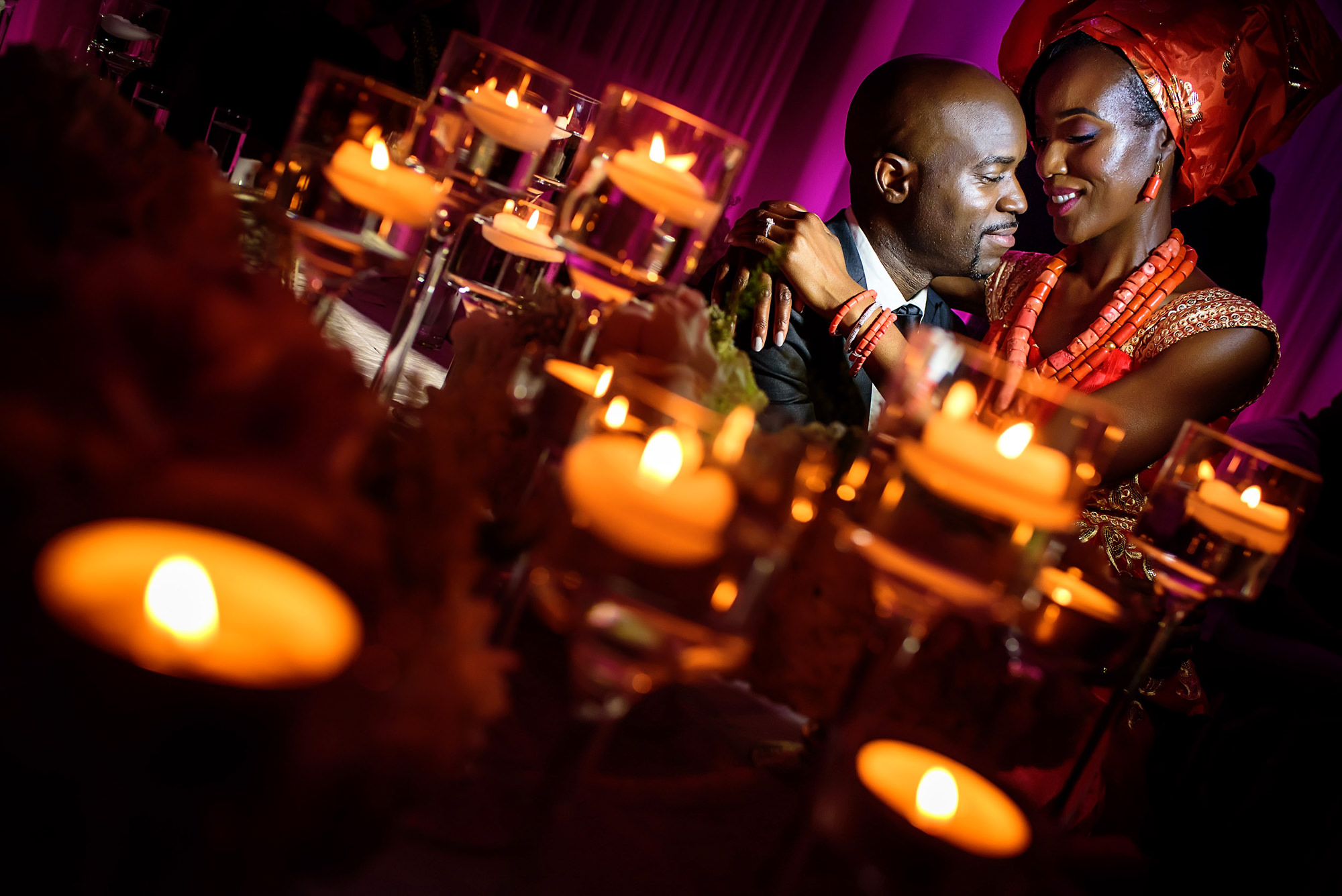 Couple in candlelight - photo by Alakija Studios