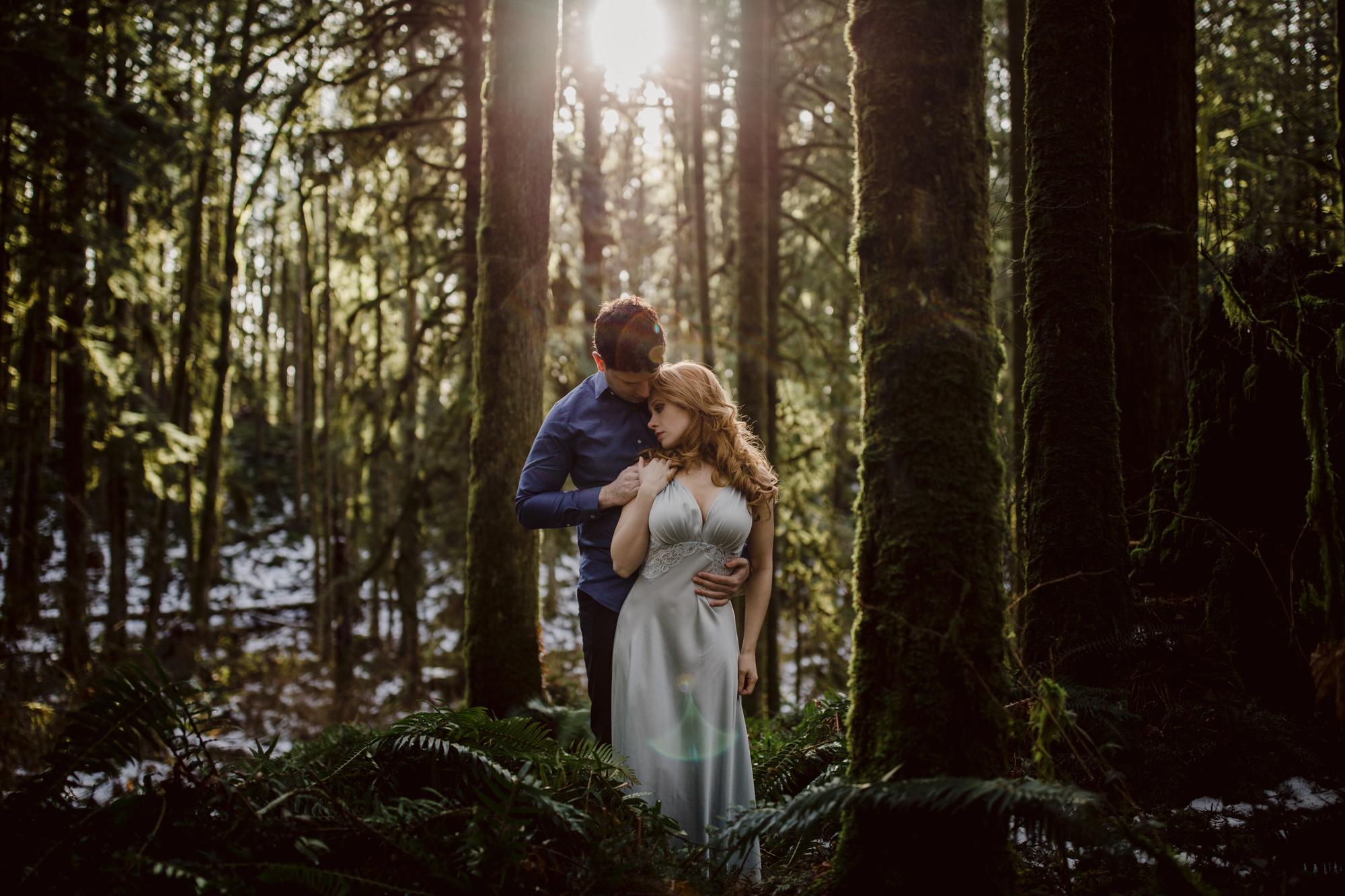 Couple in forest bride wearing soft silk dress with plunging V-neck - photo by McClintock Photography Agency