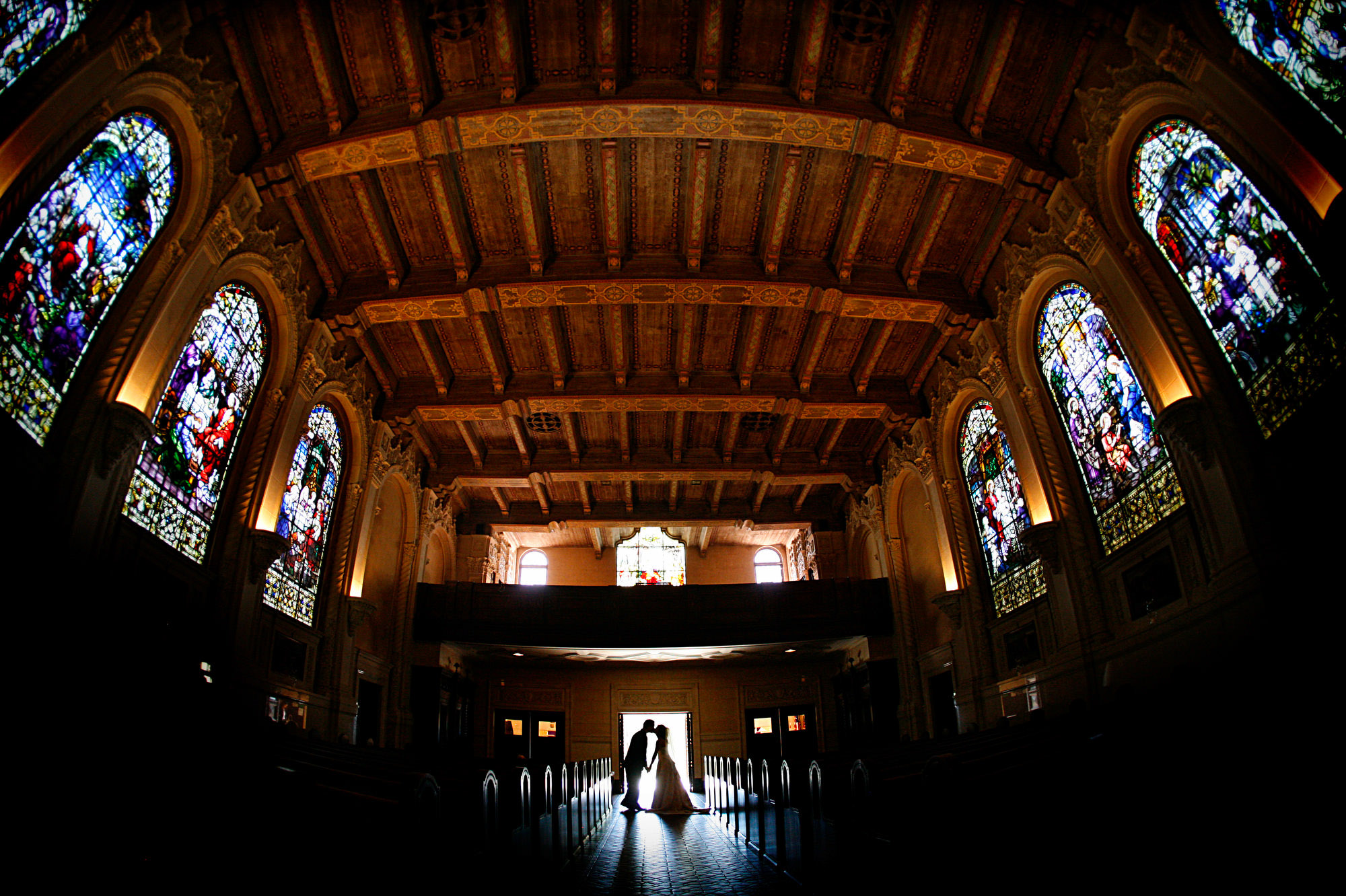 Silhouette of Couple kissing in church - photo by Jerry Ghionis