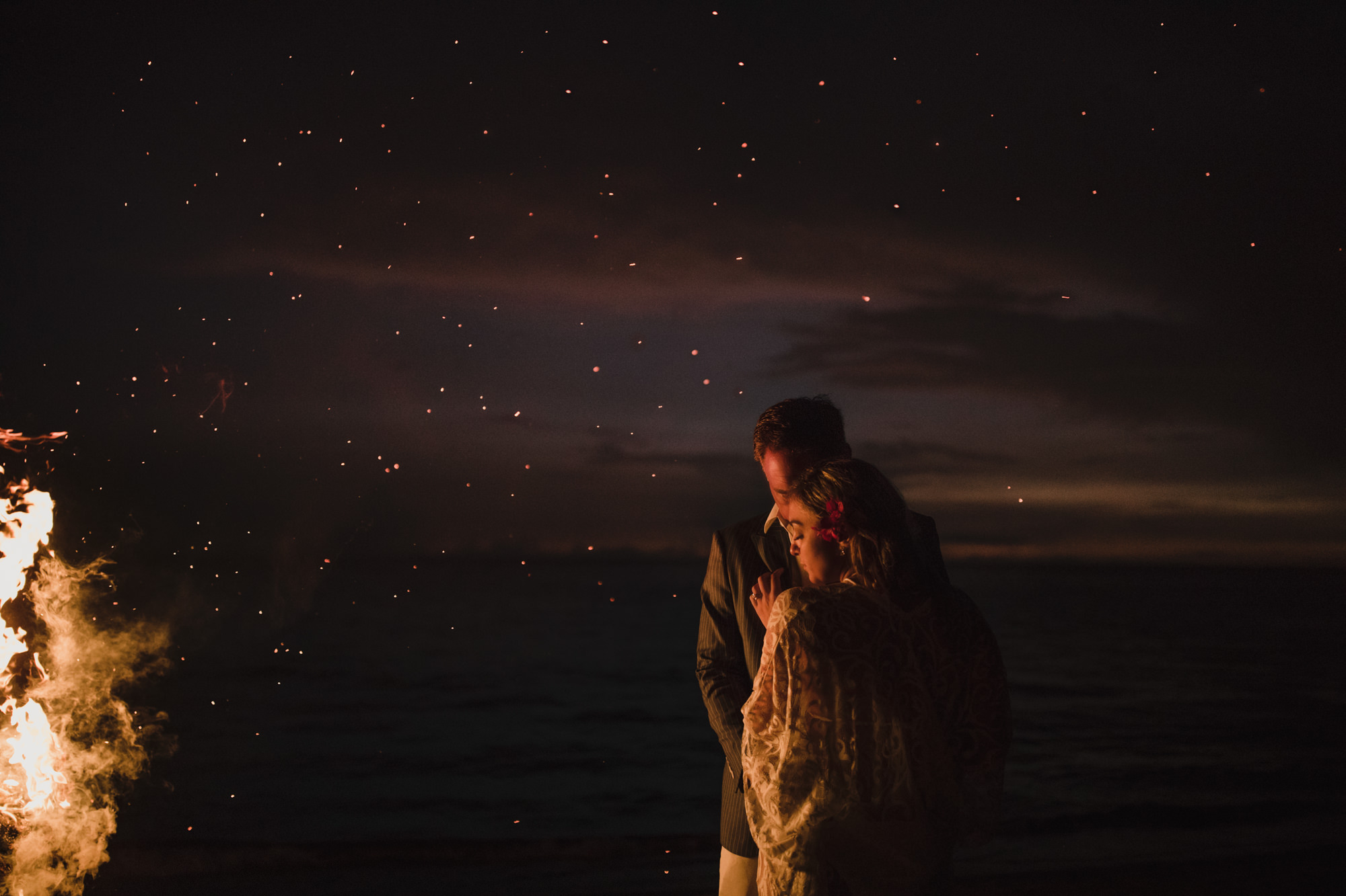 Couple by firelight under the stars - photo by McClintock Photography Agency