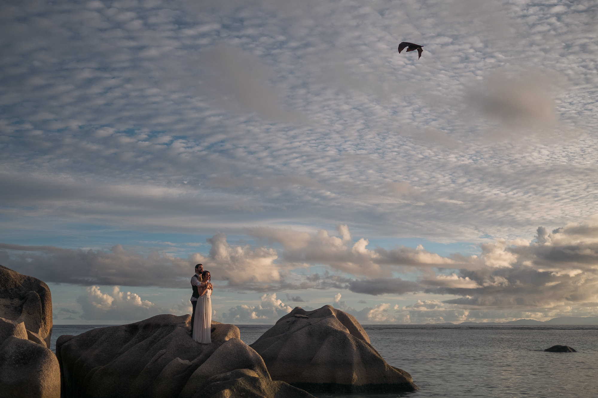 Couple portrait against beautiful clouds seaside  photo by Nordica Photography