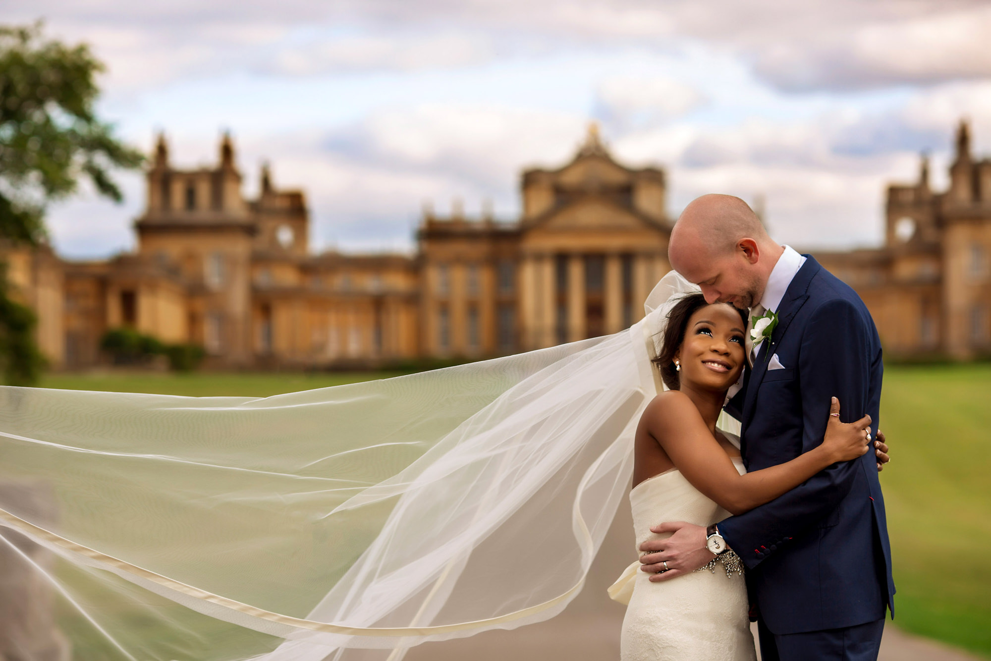 Bride and groom at historic site - photo by Alakija Studios