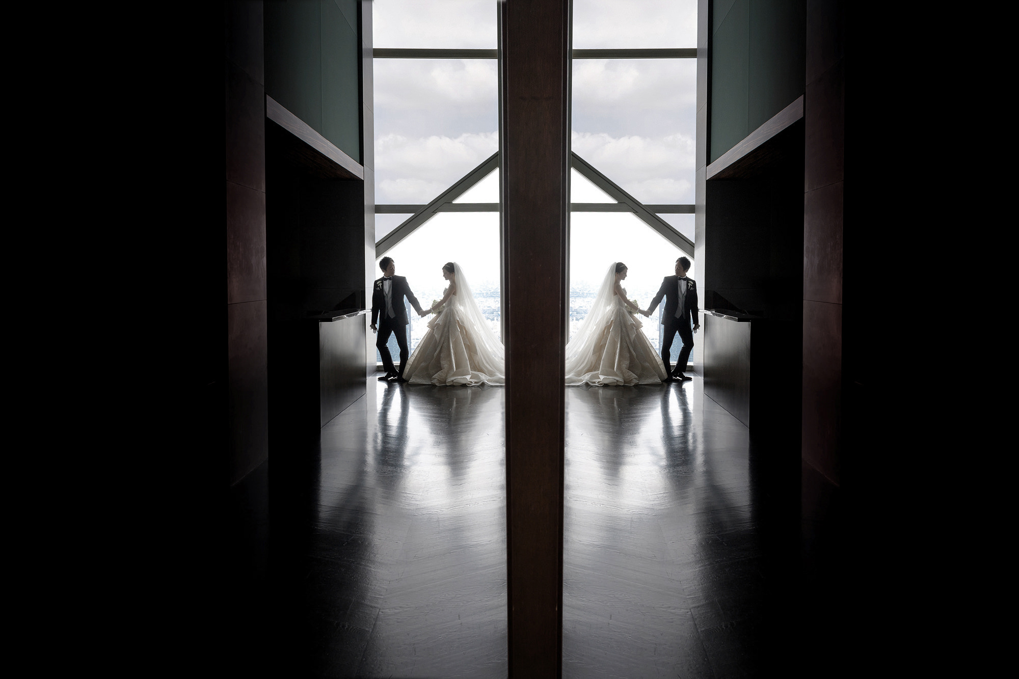 Composite photo of bride and groom in window  -  photo by 37 Frames