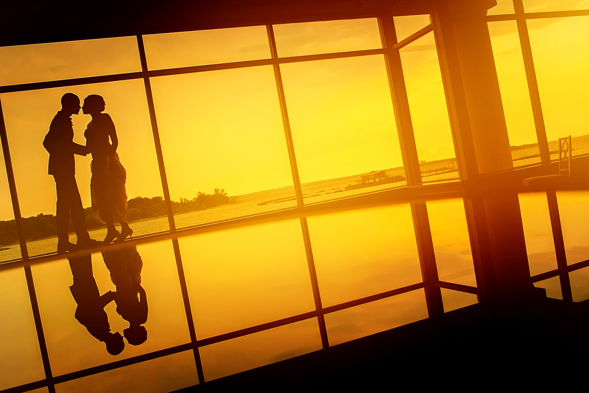 Couple silhouette reflection - photo by Alakija Studios