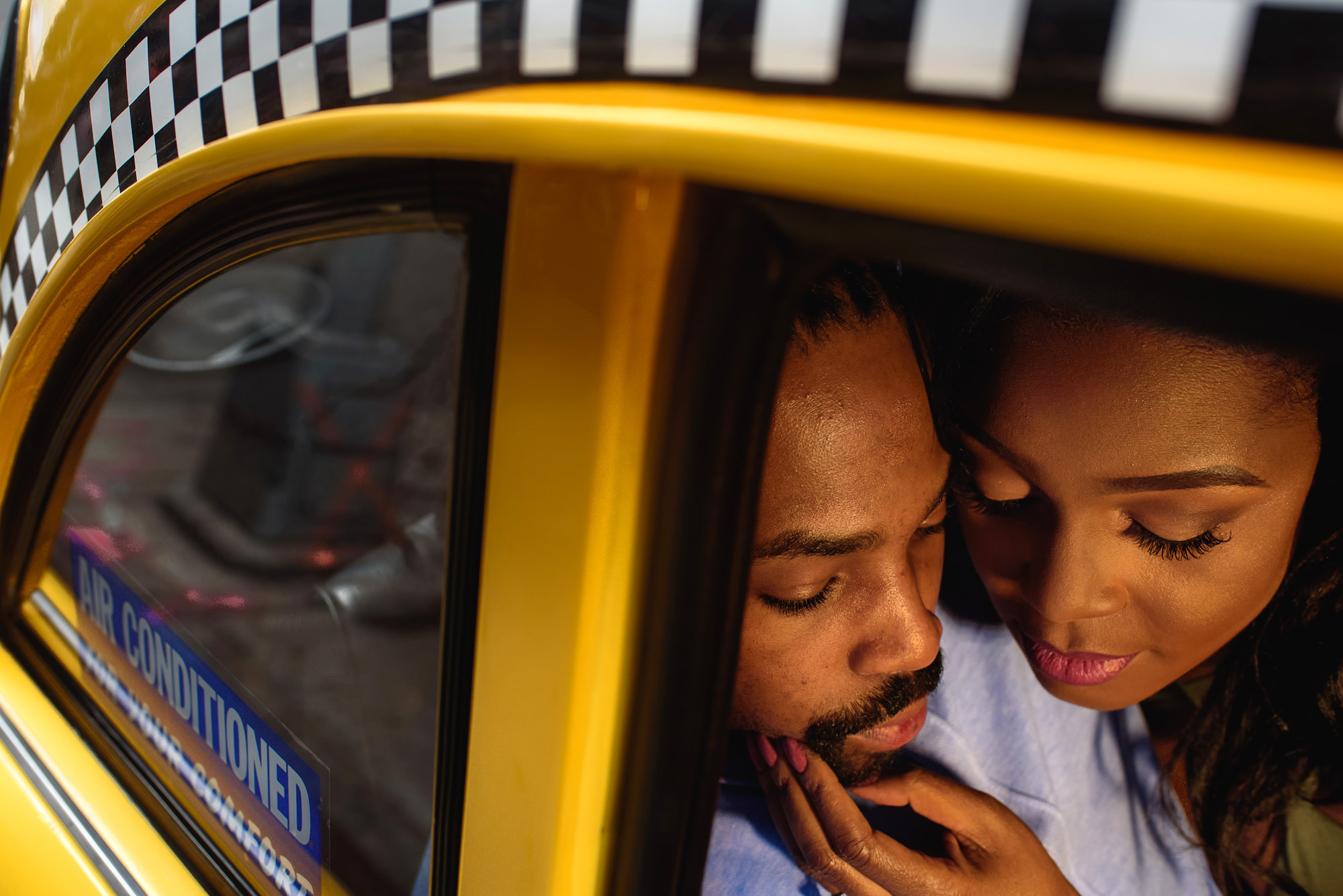 Couple in checkered taxi - photo by Alakija Studios