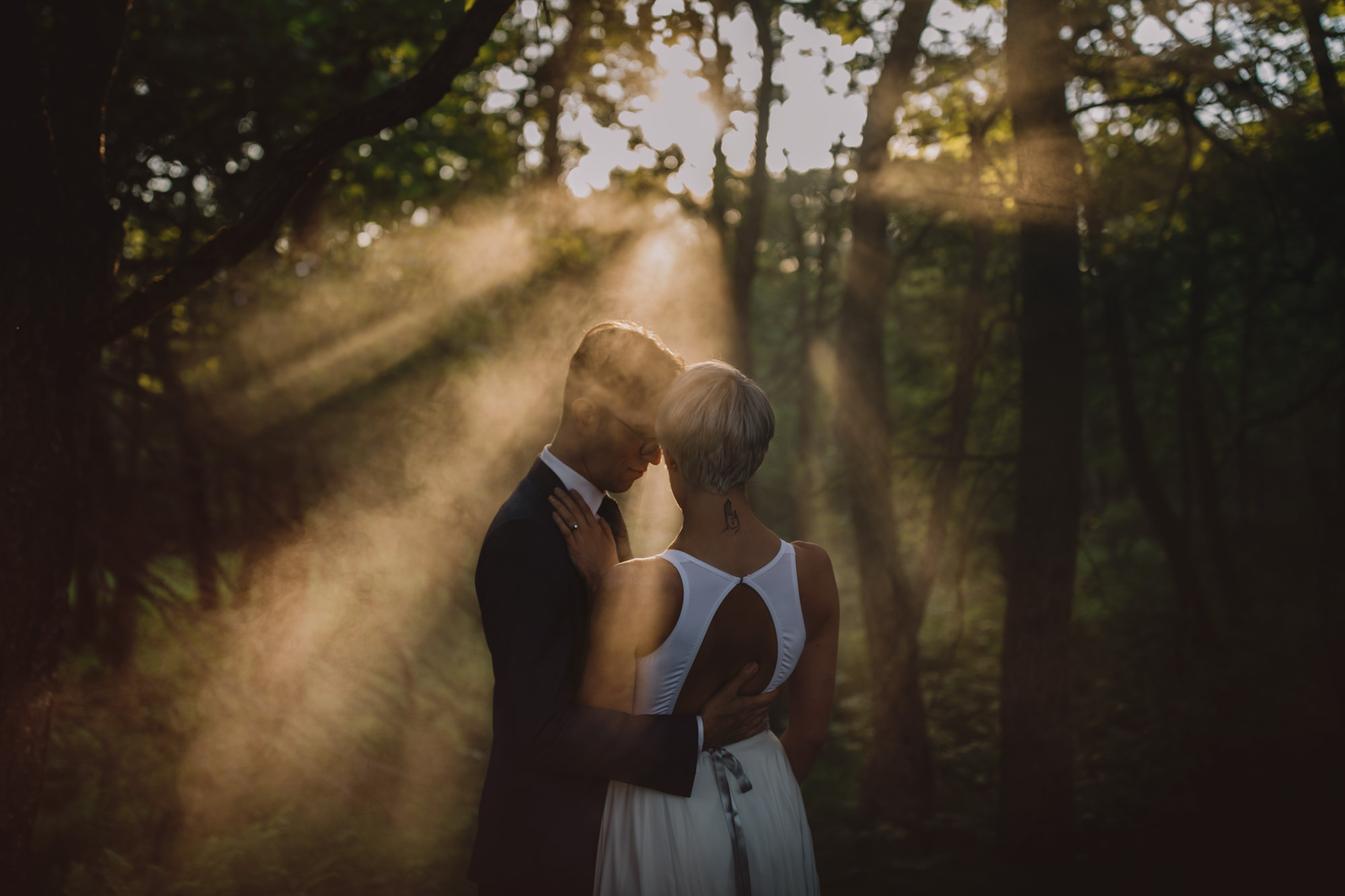 Couple in forest in sun rays - McClintock Photography Agency