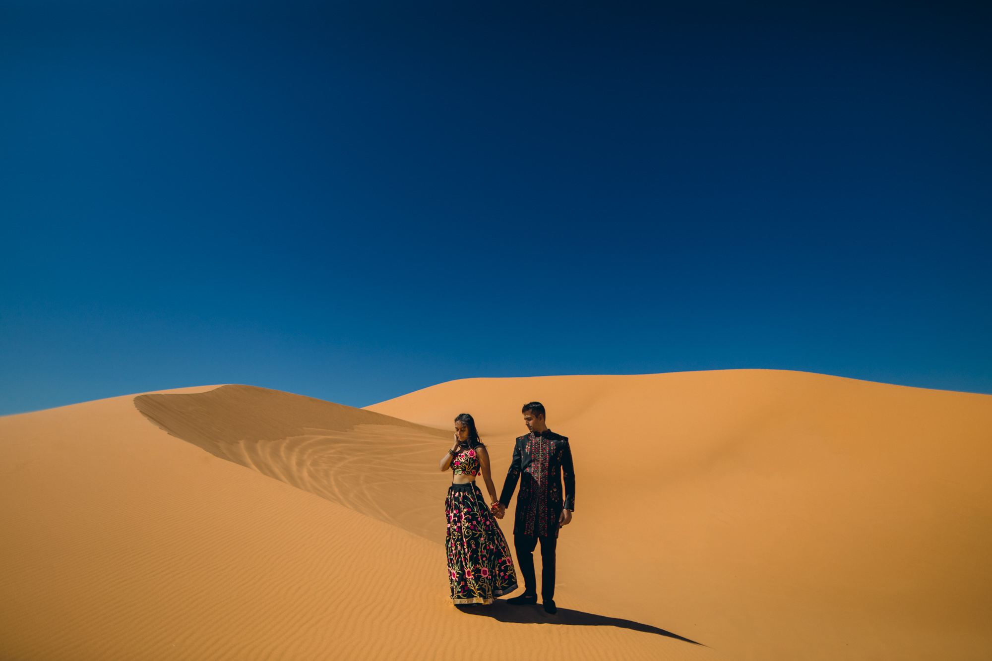 Engagement couple wearing embroidered Spanish attire - photo by McClintock Photography Agency