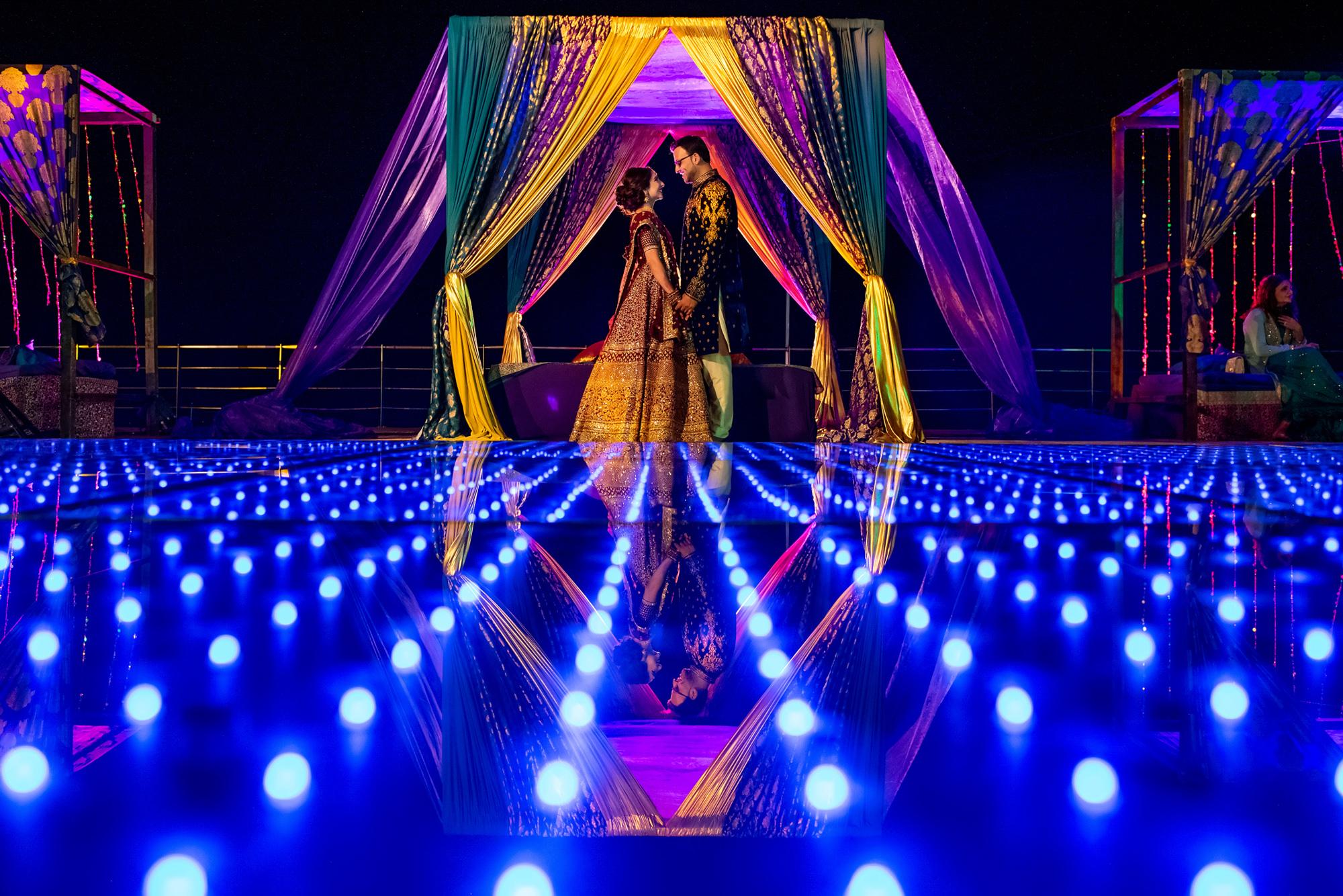 Couple with Indian sari draped reception tent - Morgan Lynn Photography