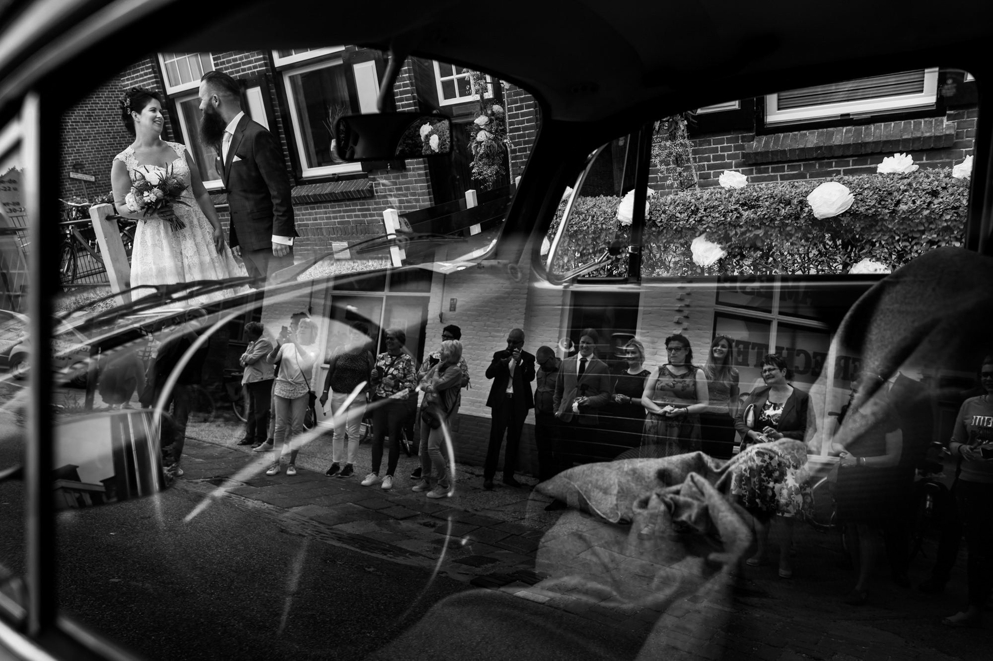 Creative Reflection of couple and guests photo by Fotobelle: Isabelle Hattink
