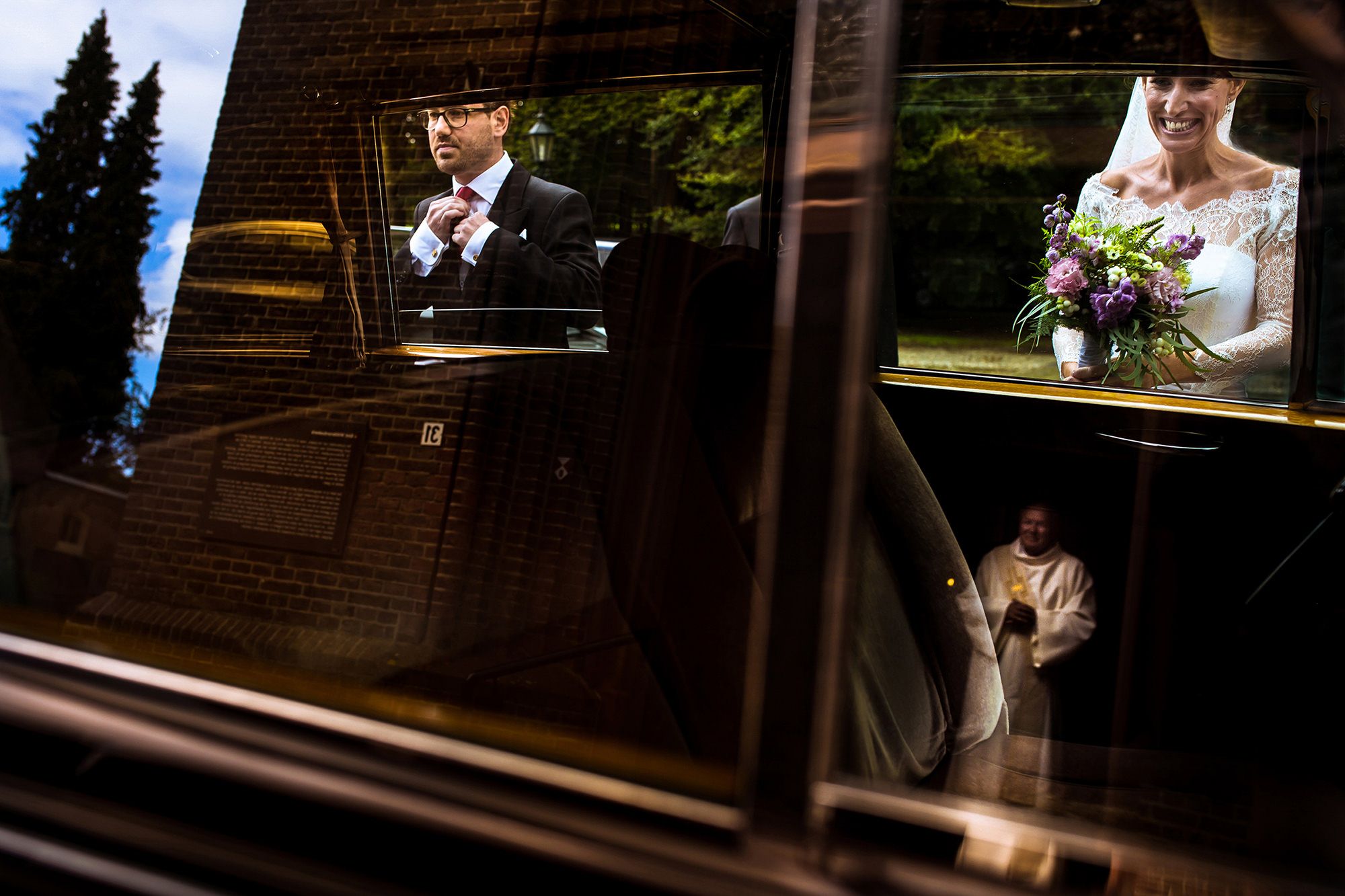 Creative composition reflections of bride and groom getting into limo photo by Fotobelle: Isabelle Hattink
