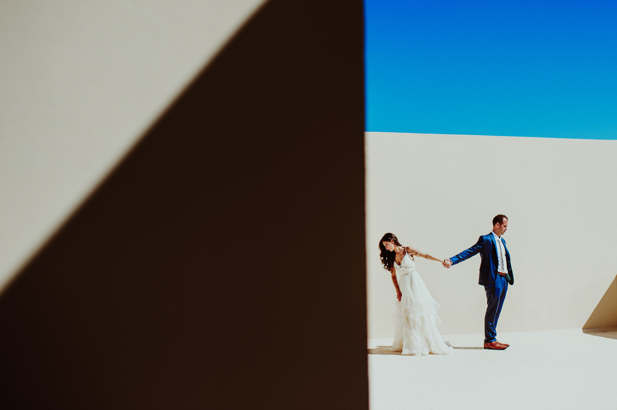 Creative portrait of bride and groom using geometric composition