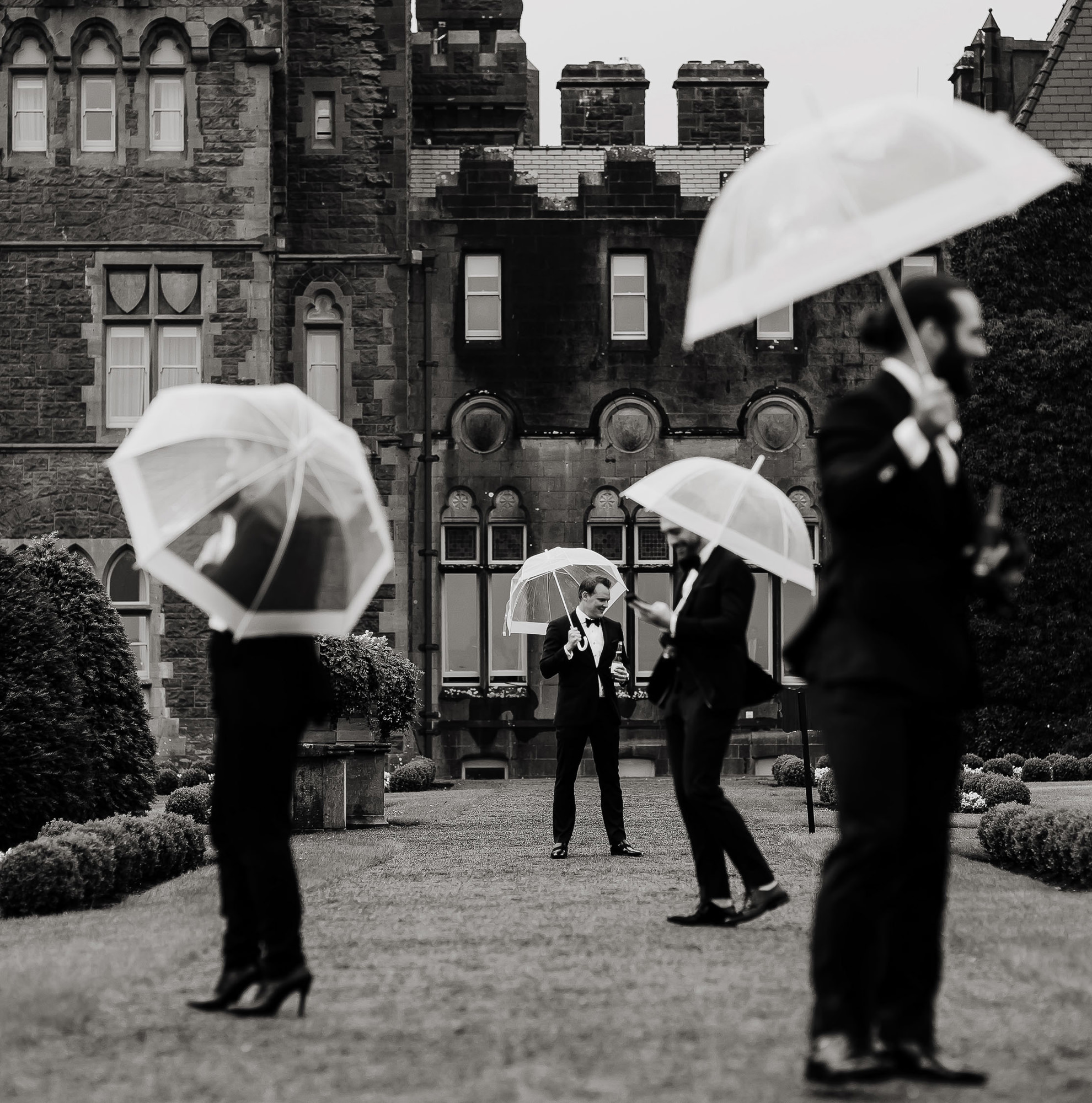 black and white photo of groomsmen with umbrellas - photo by The Brenizers - NYC