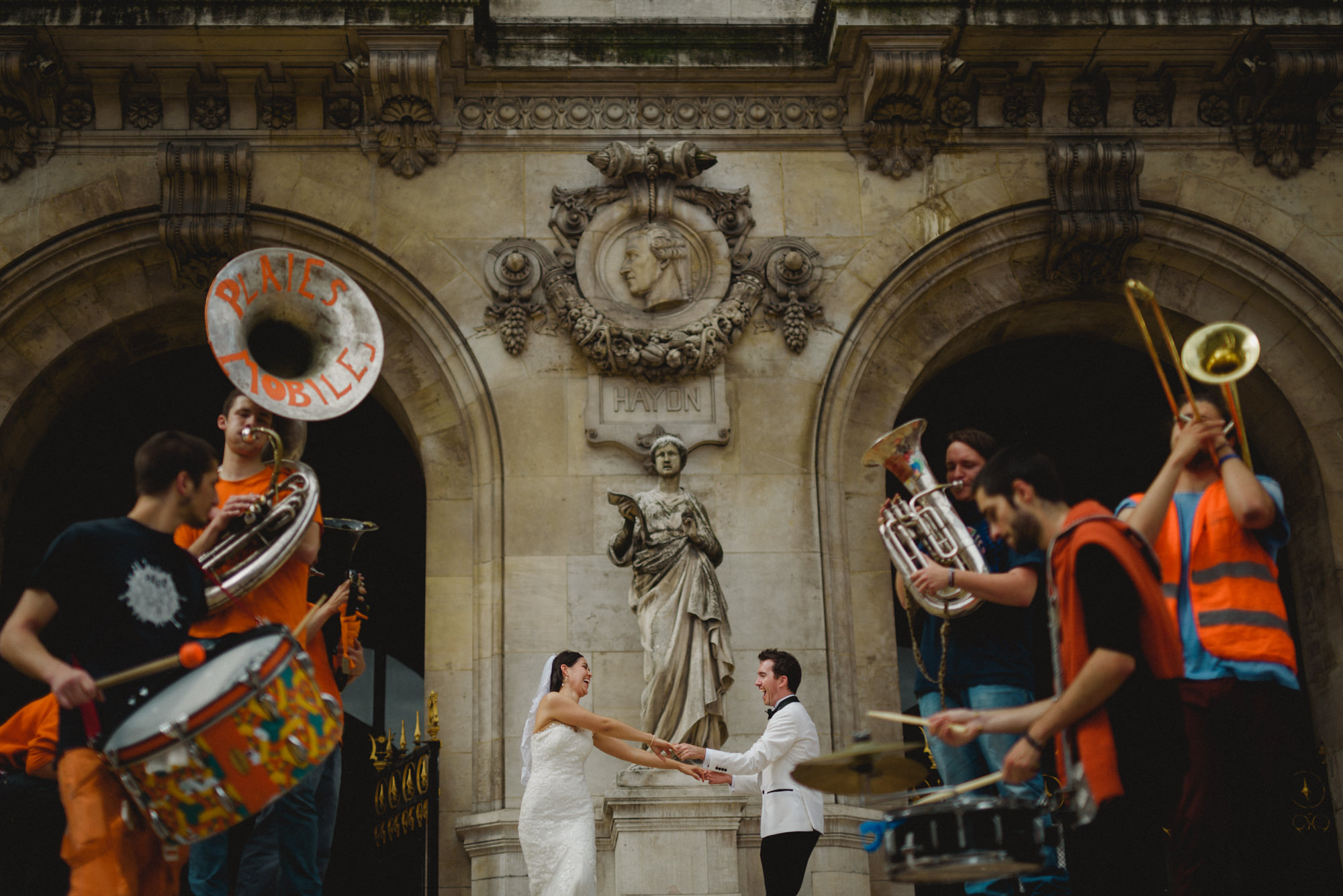 Couple dancing to brass band - photo by Fer Juaristi