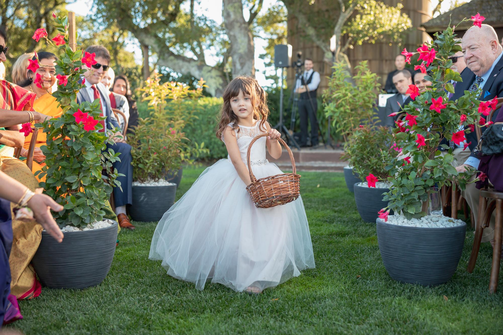 Darling flower girl goes down the aisle  - Roberto Valenzuela Weddings