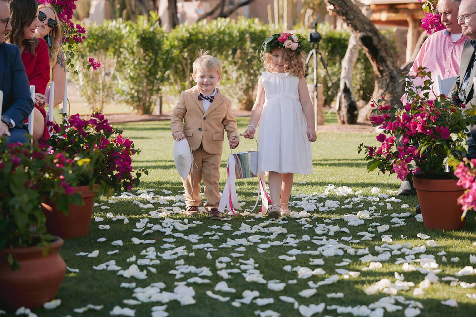 Darling ringer bearer and flower girl come down rose petal aisle - Roberto Valenzuela Weddings
