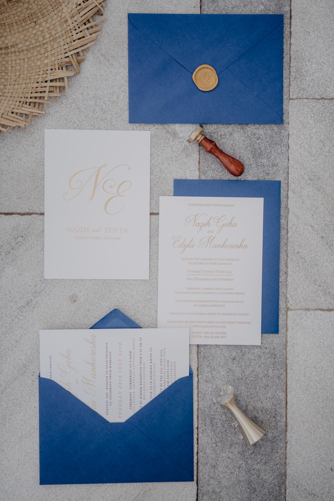 Denim blue wedding invitations with gold calligraphy - photo by David Bastianoni