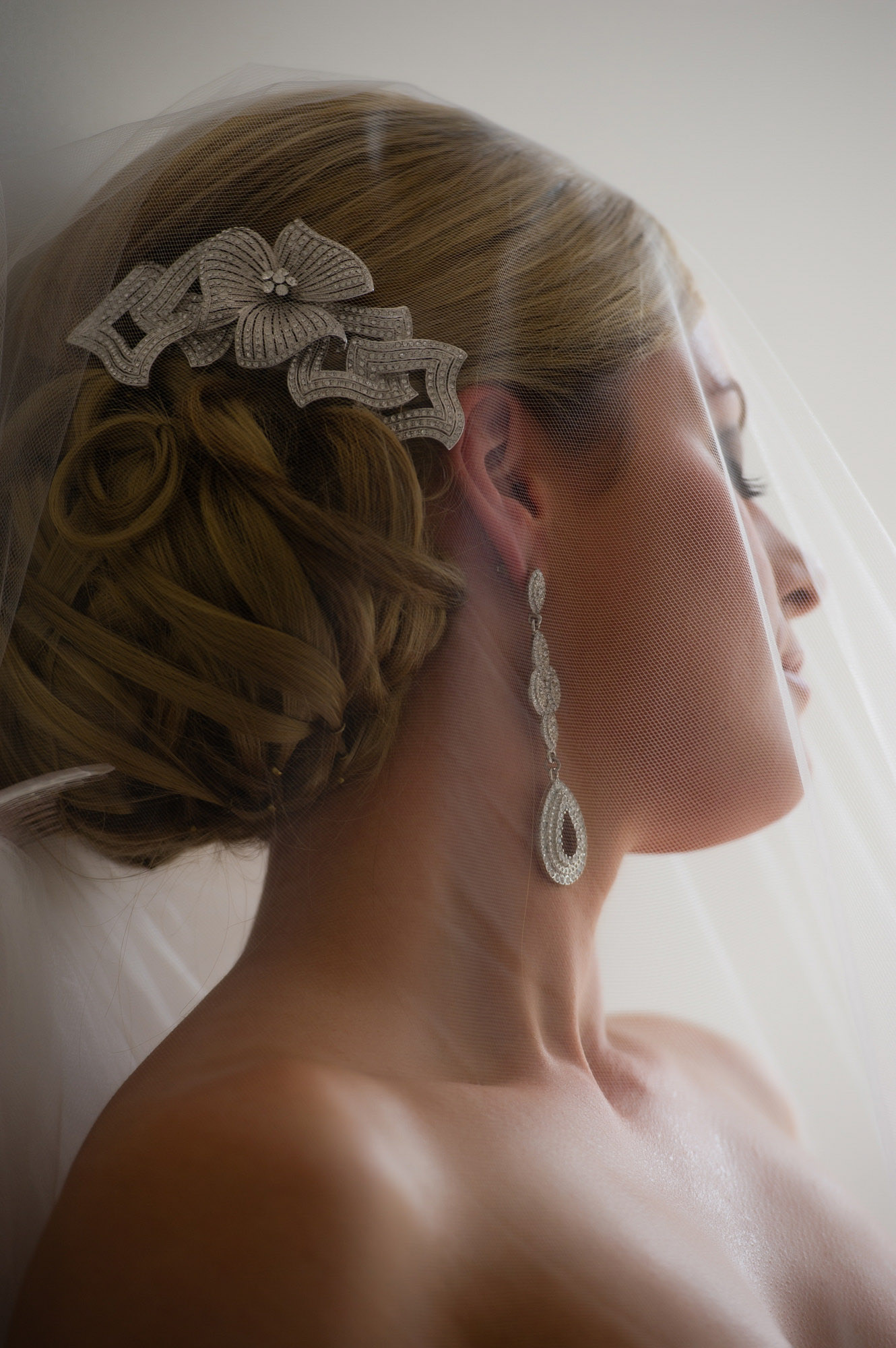 Portrait of bride with diamond bow hair accessory  by Jerry Ghionis - Australia and Nevada