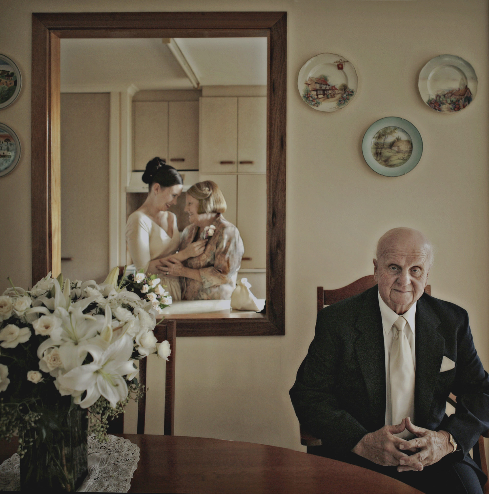 Documentary family portrait with bride and mother in mirror - Studio Impressions Photography