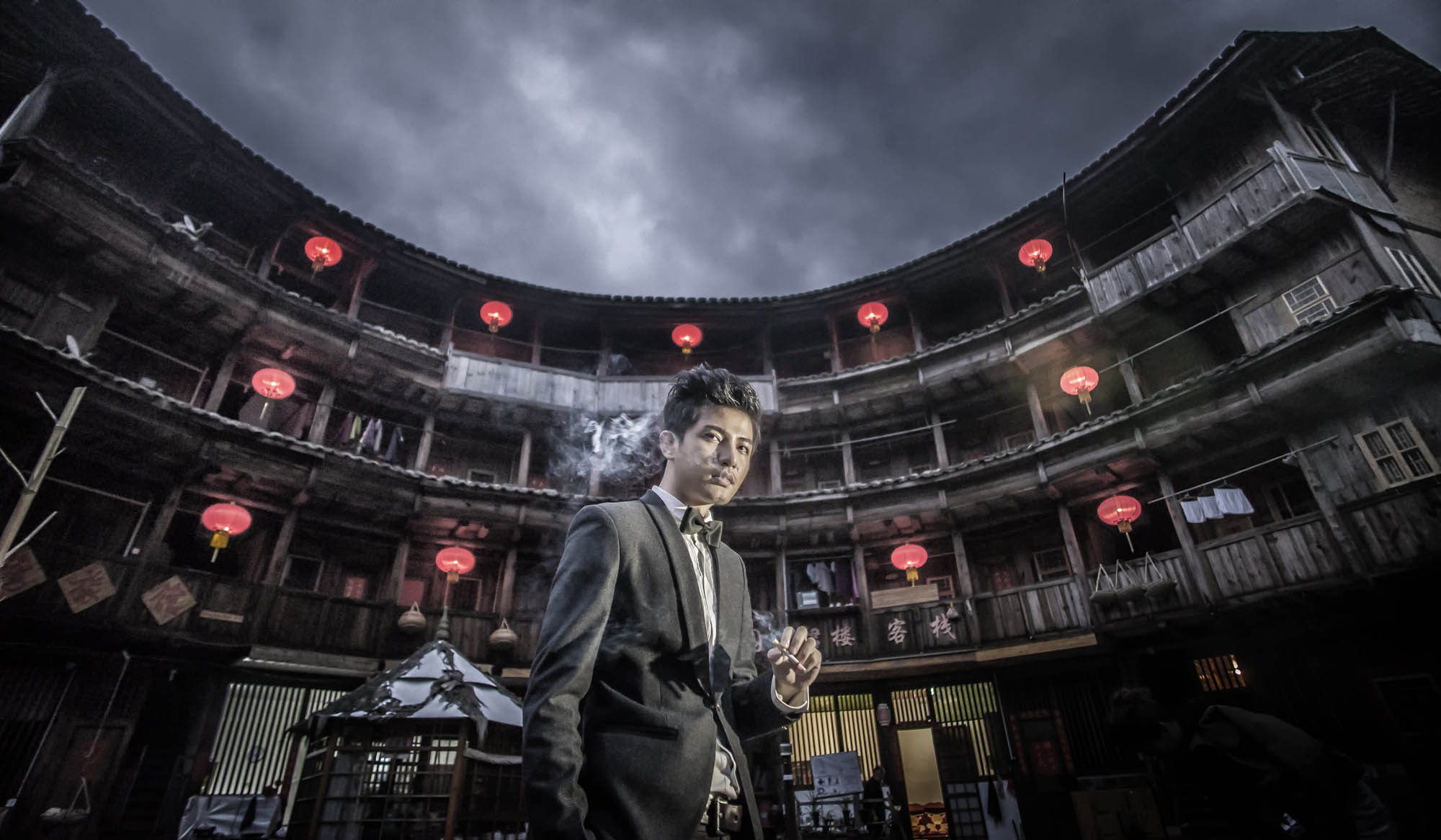 Groom smoking in front of famous Hong Kong movie site, by CM Leung