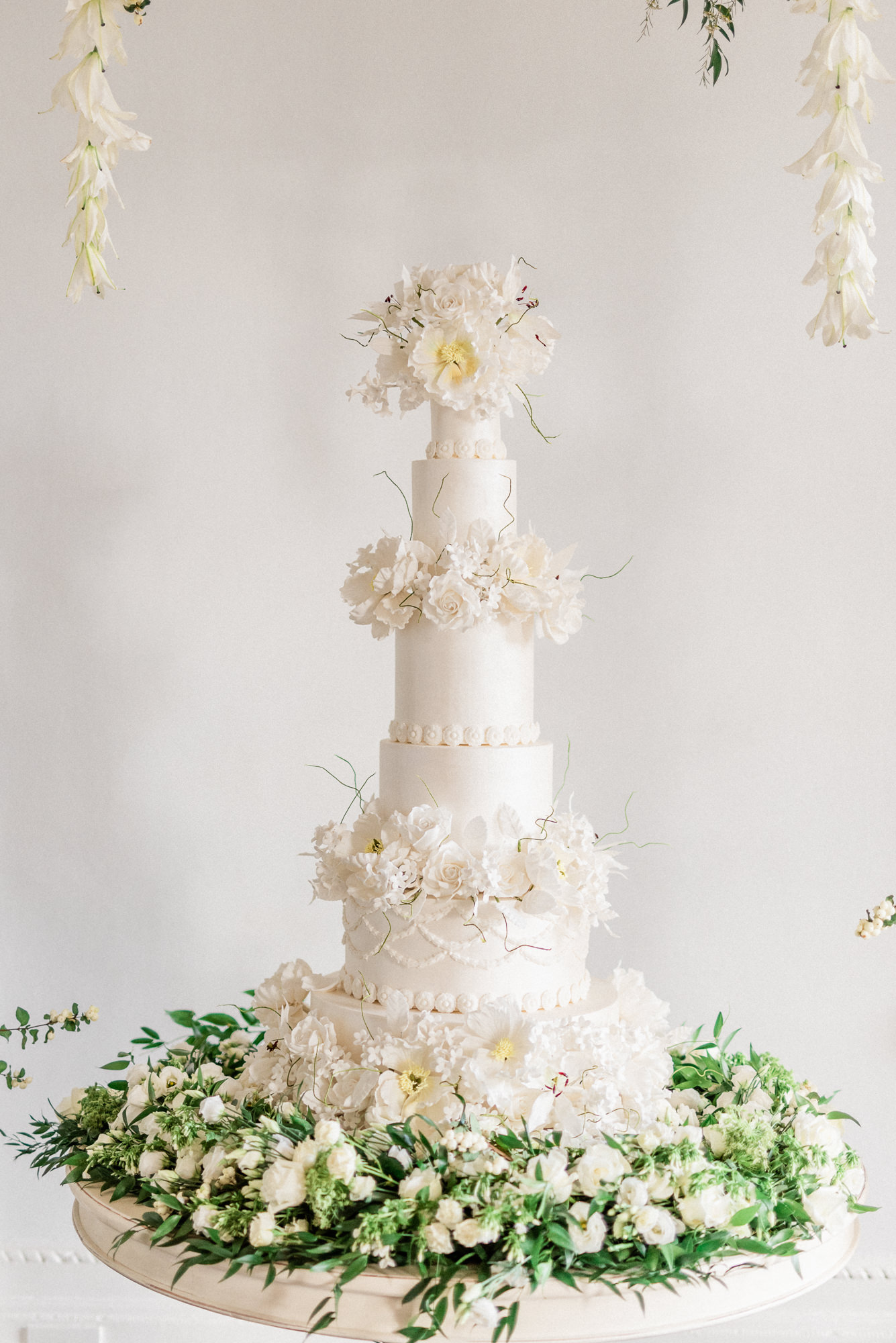 Six Tiered wedding cake with white peony top and floral layers - Gianluca Adovasio Photography