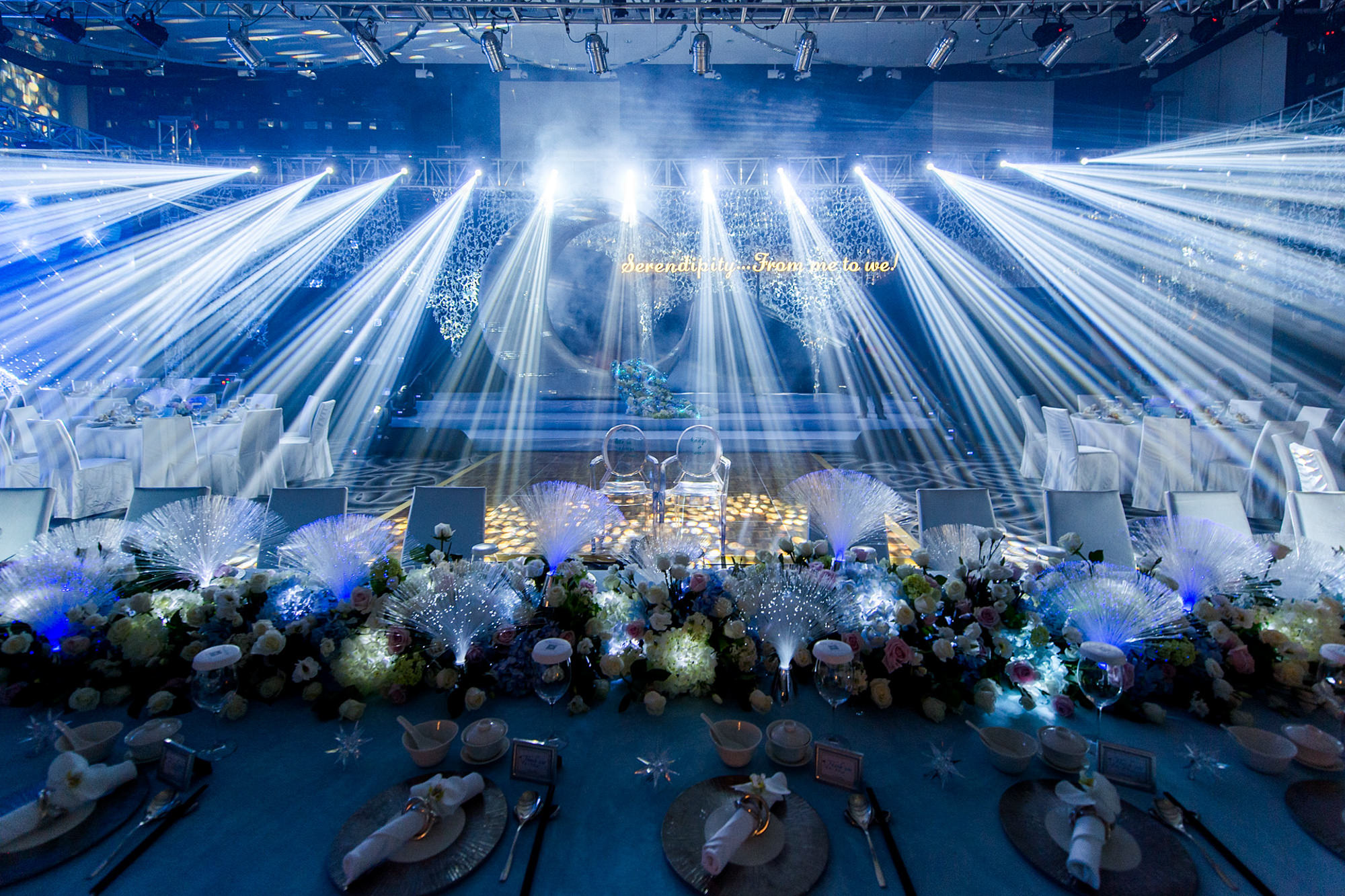 Reception decor elaborately lit with blue spotlights - Studio Impressions Photography