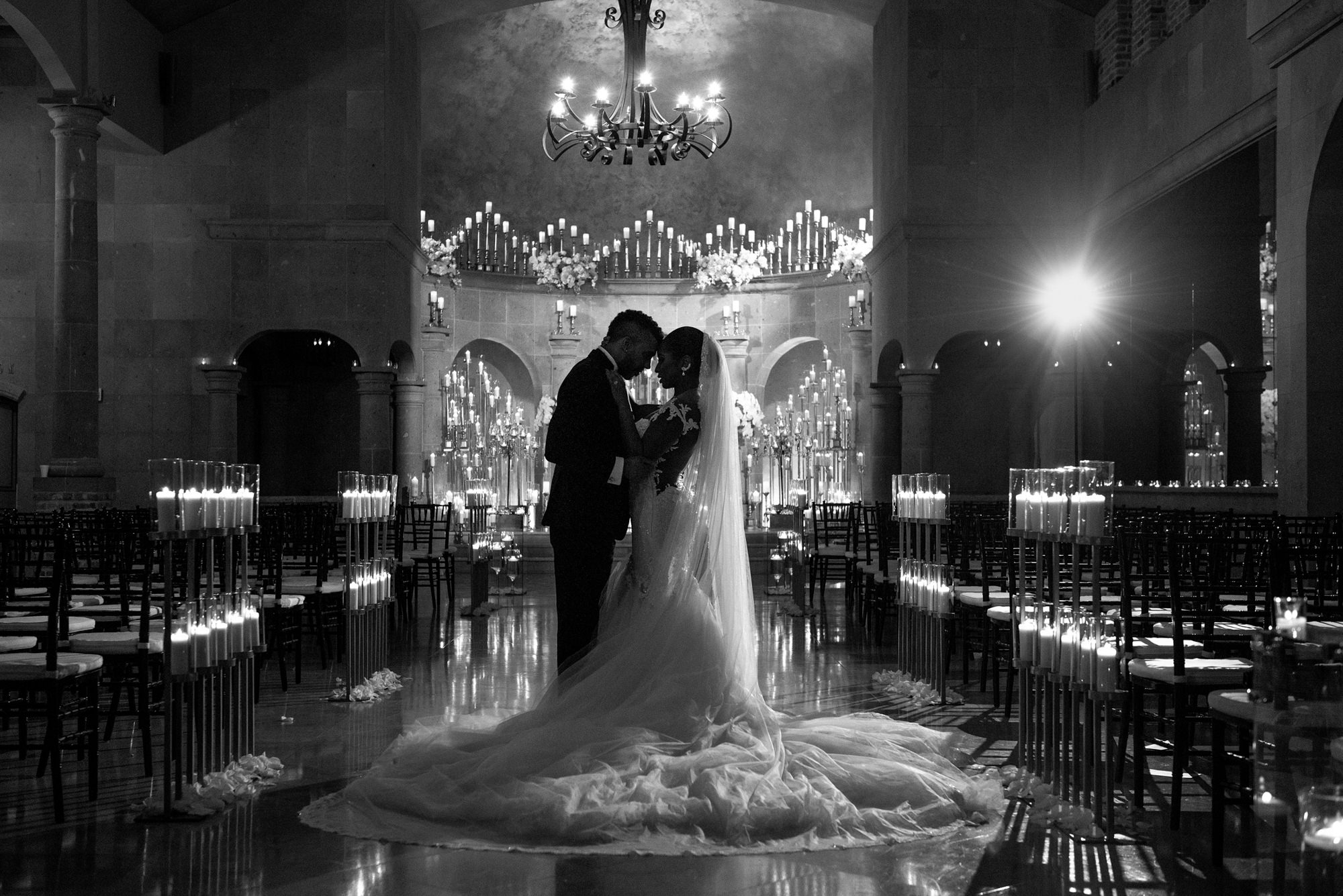 Couple embracing in candlelit church -  Morgan Lynn Photography