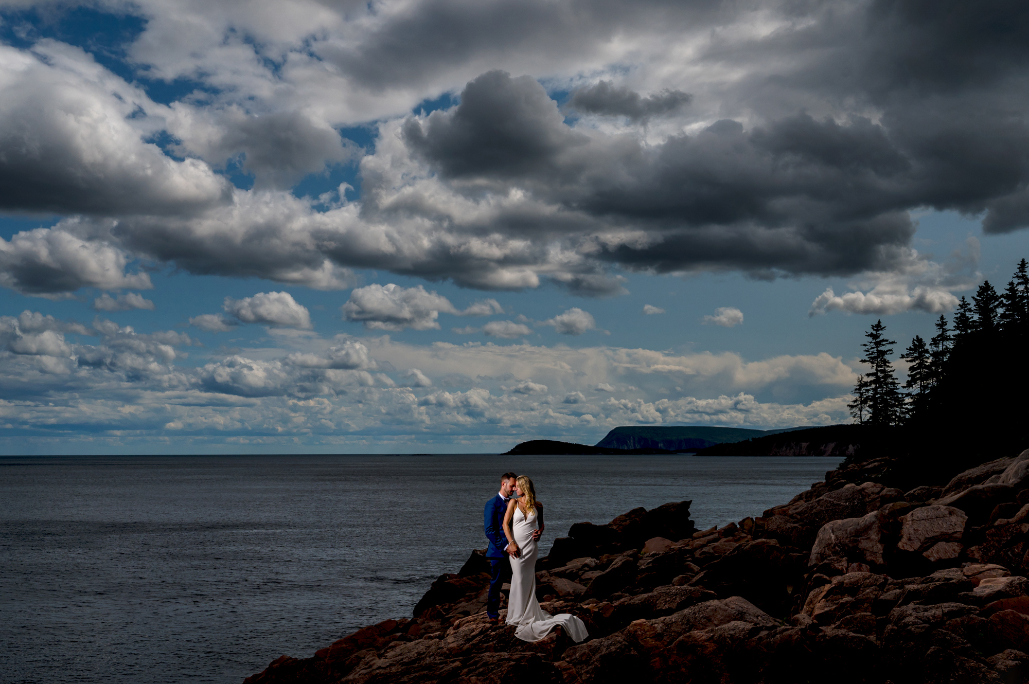 Elegant couple under cloudy skies - photo by Cooked Photography