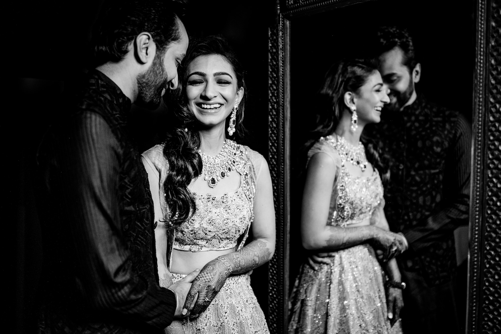 Elegant Indian couple reflected in mirror image by Rimi Sen