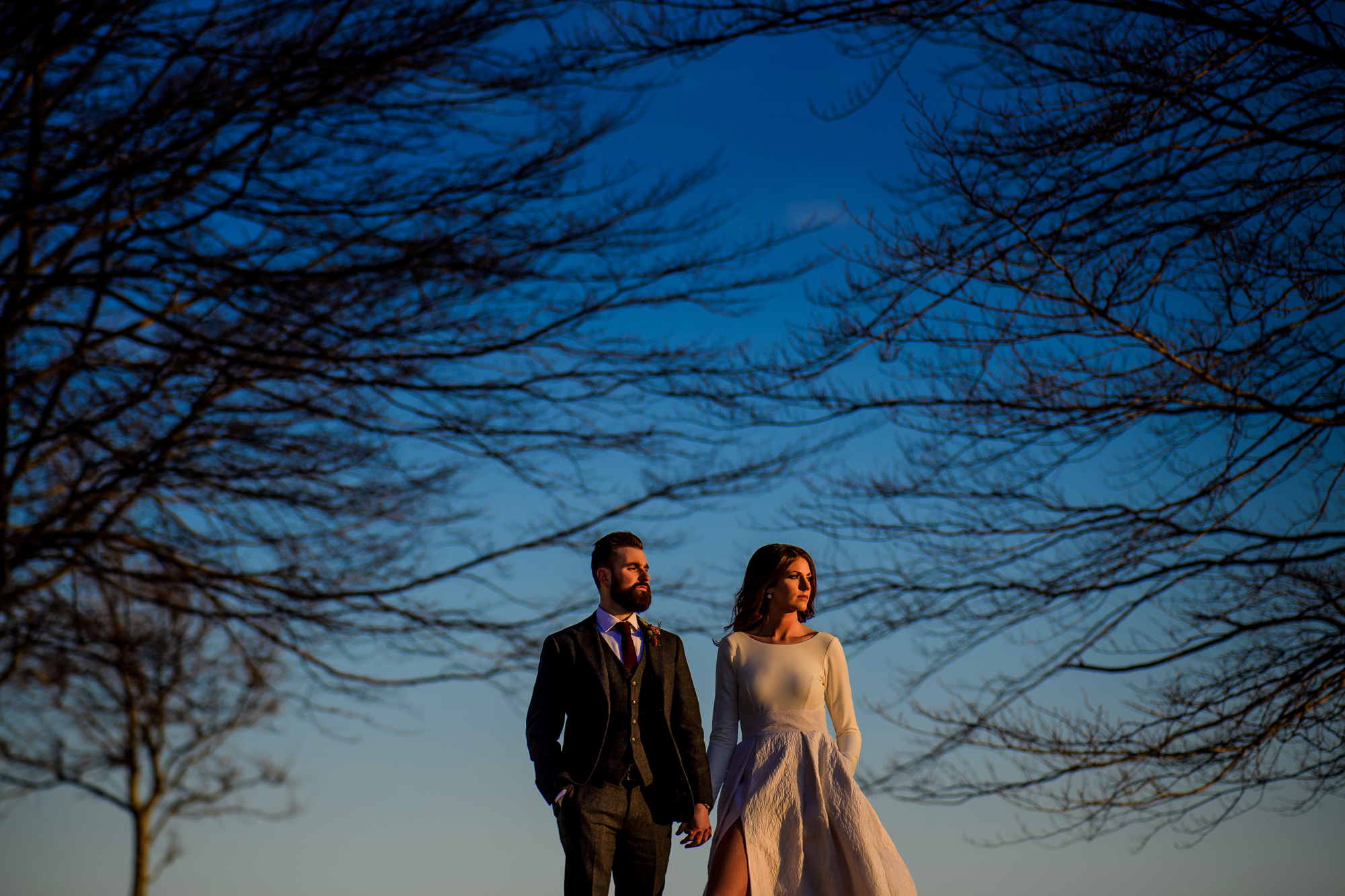 Elegant couple walking outdoors - photo by Cooked Photography