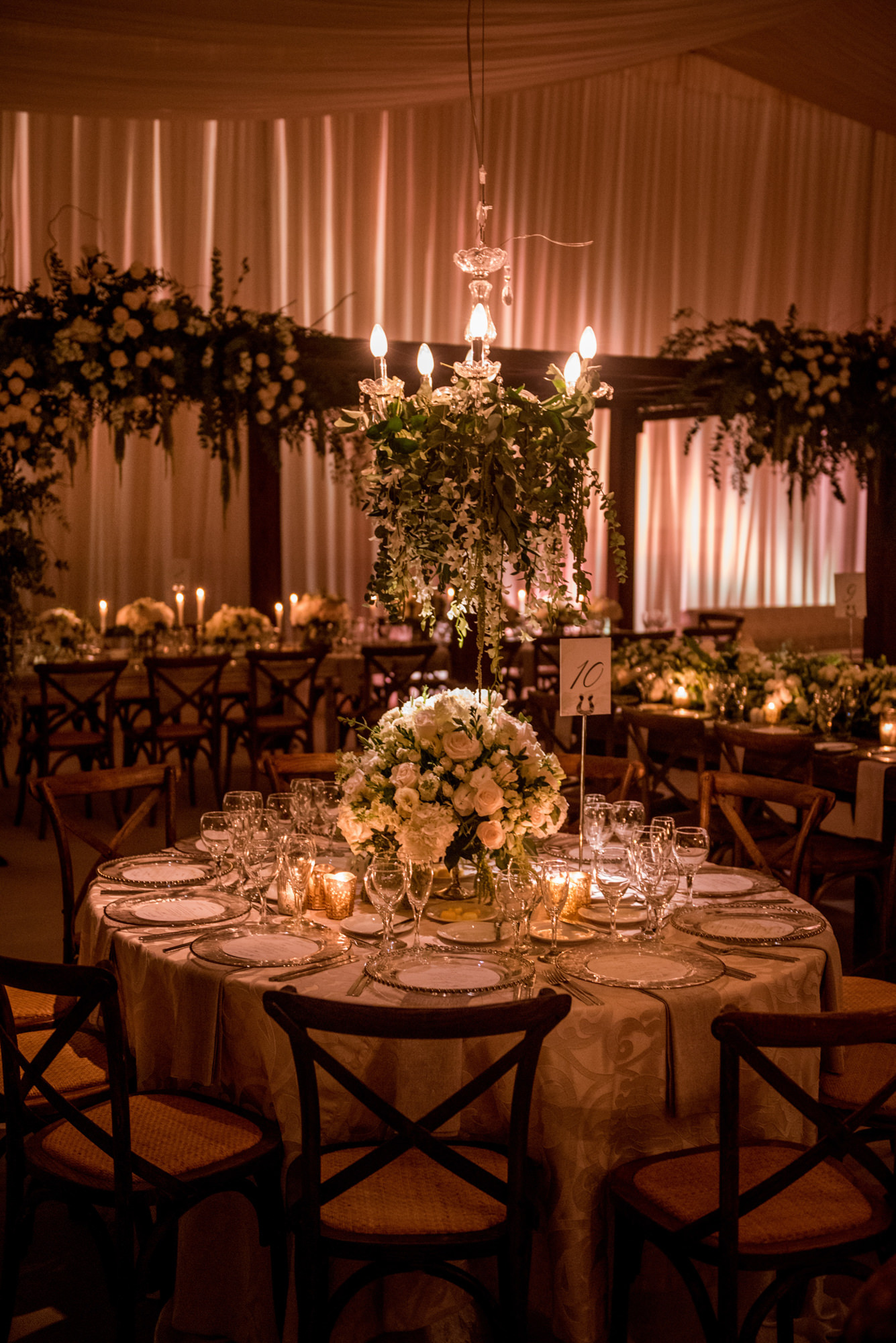 Elegant tent reception with pink lighting  - Morgan Lynn Photography