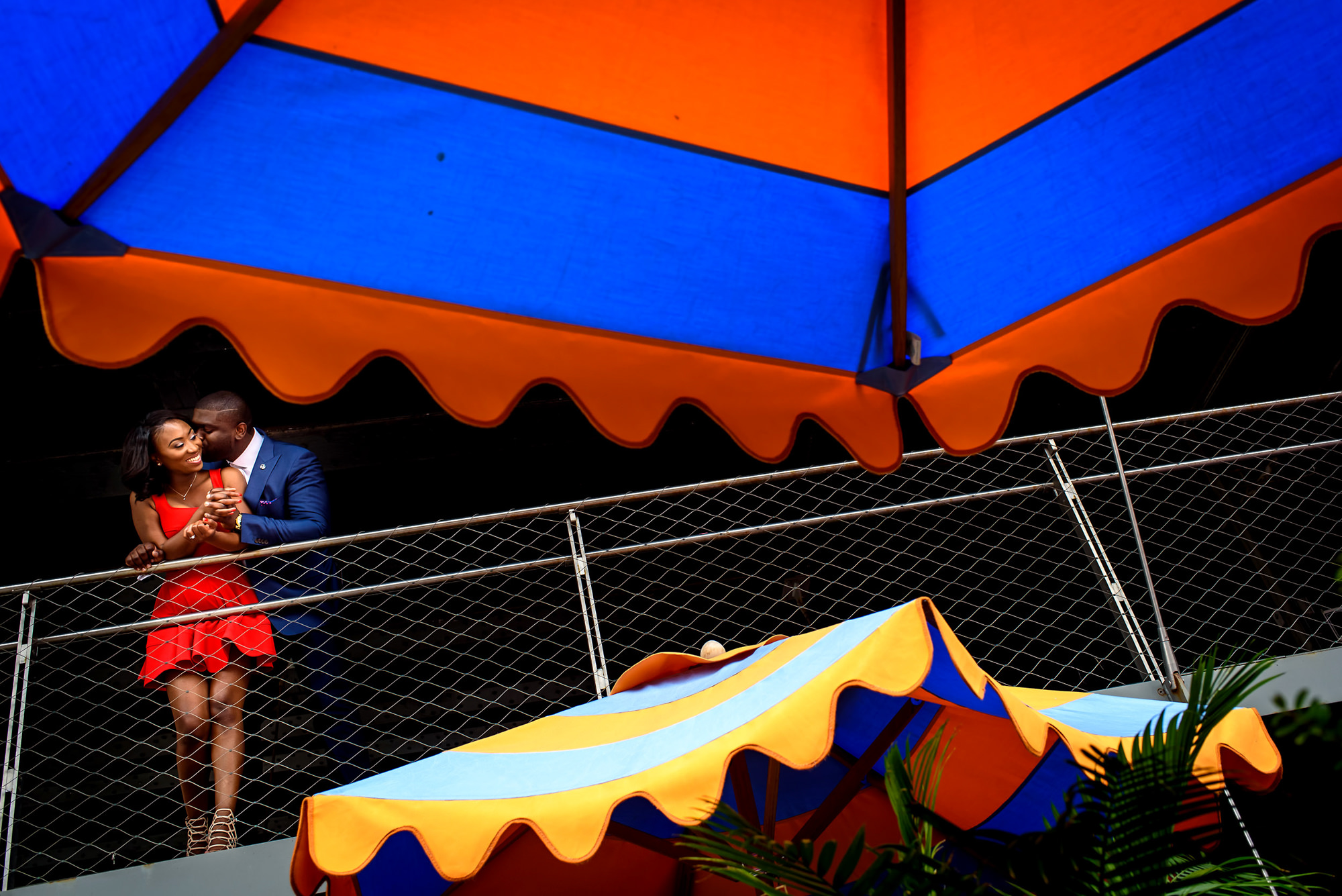 Fun couple portrait with colorful umbrellas - photo by Alakija Studios