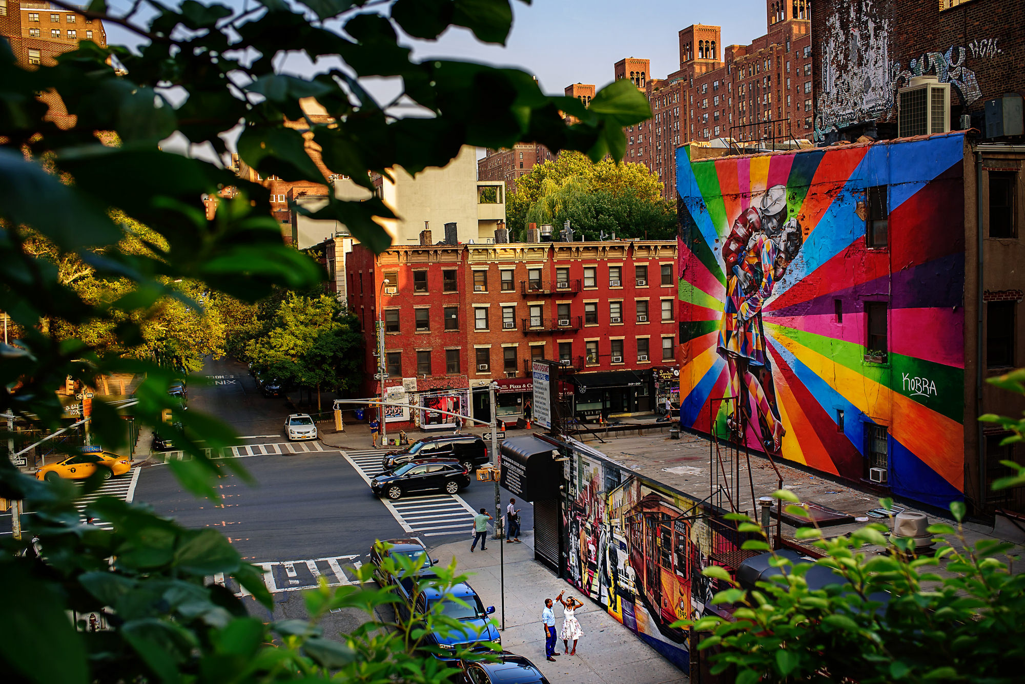 Engagement couple on colorful New York street - photo by Alakija Studios