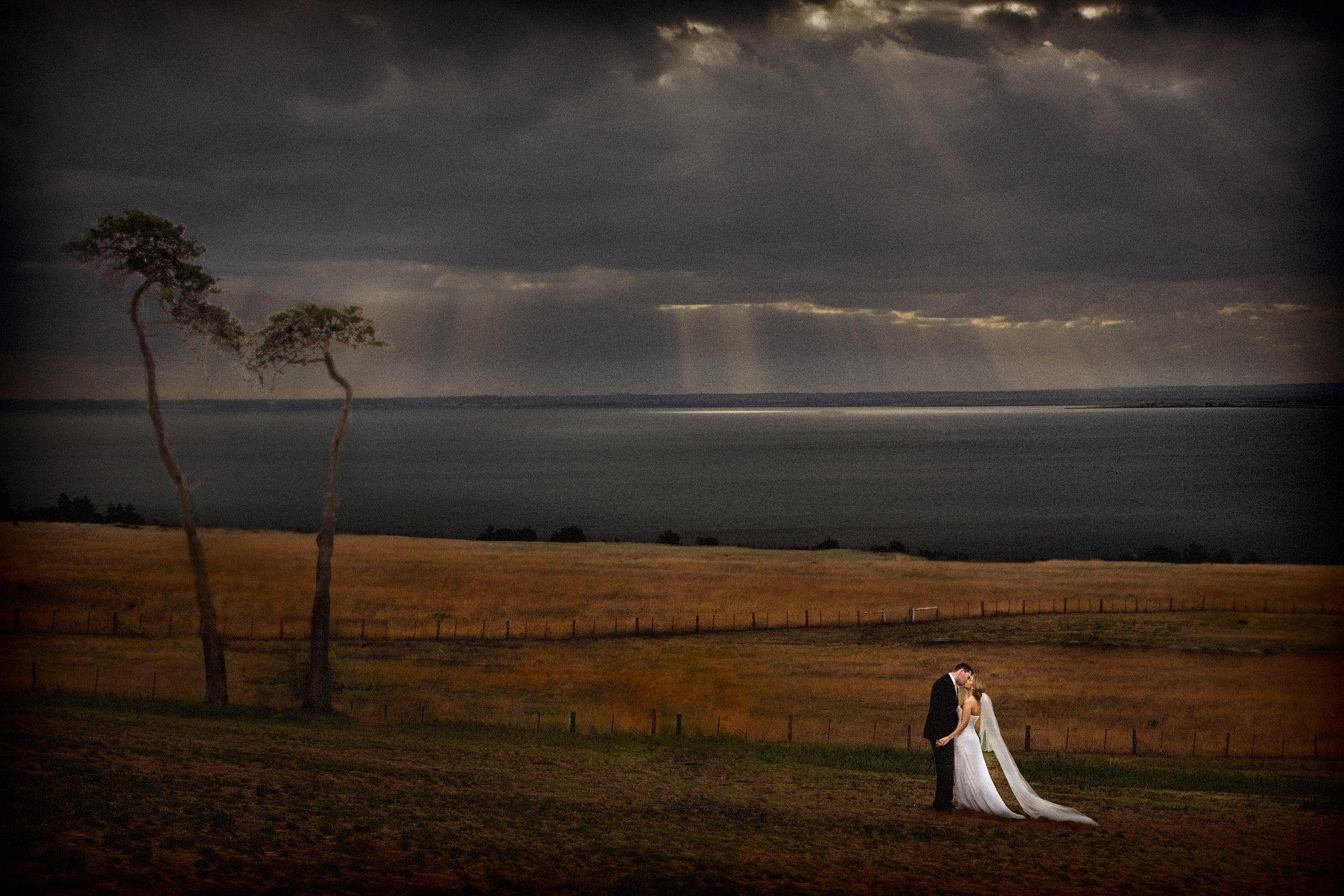 Landscape portrait of couple in open Australian field by Jerry Ghionis