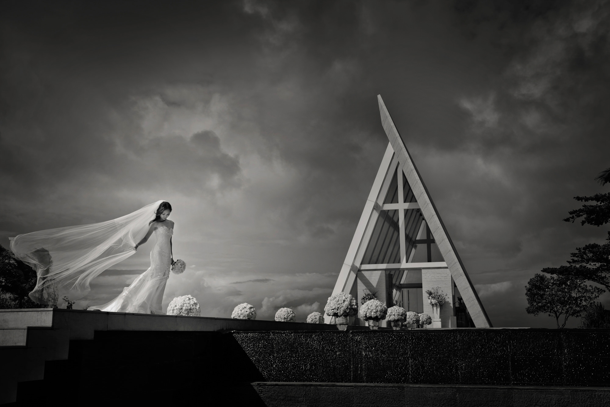 Bridal portrait at A-frame chapel with floral aisle  -  Studio Impressions Photography