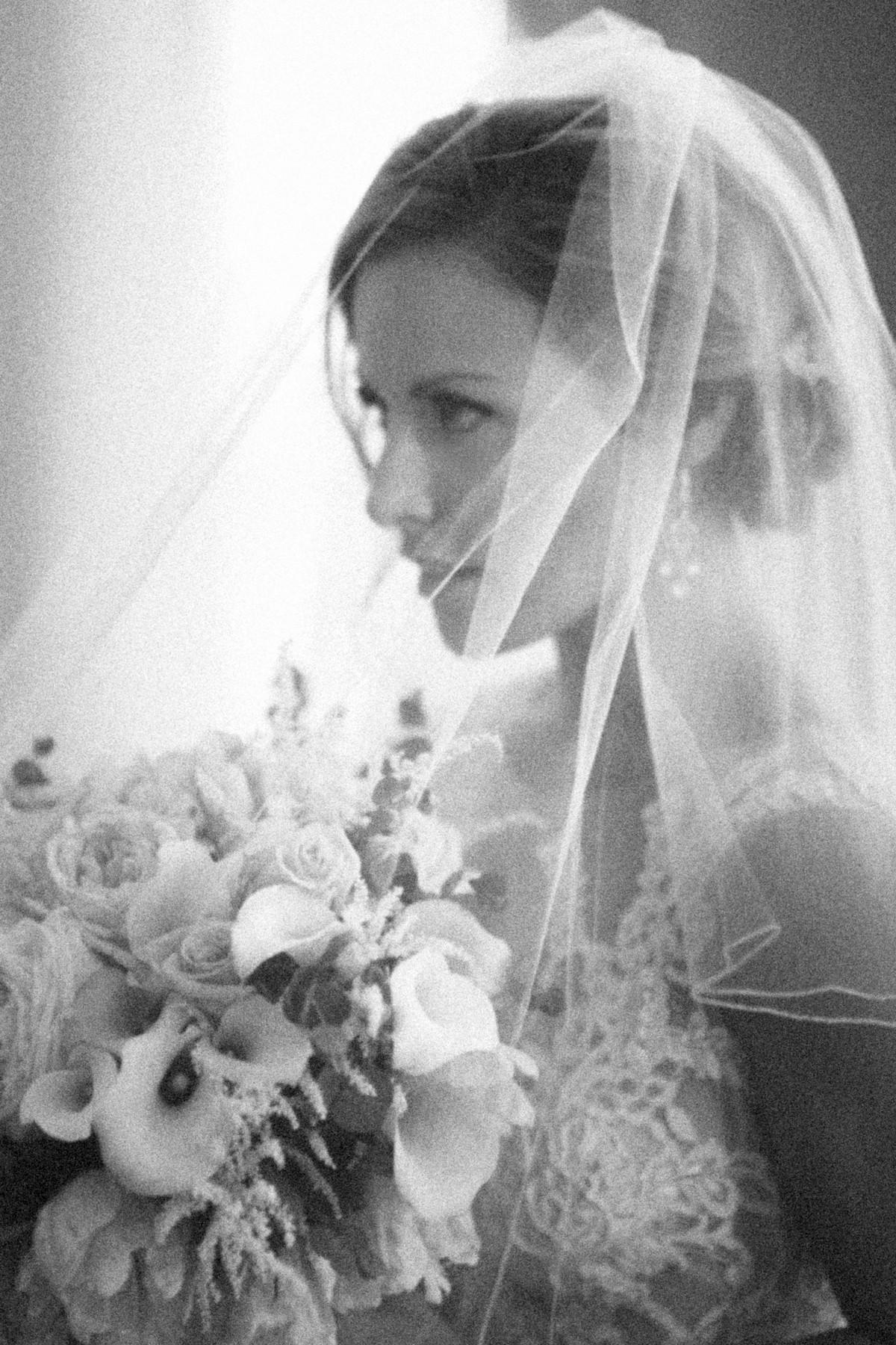 Romantic portrait of bride under veil by John and Joseph Photography