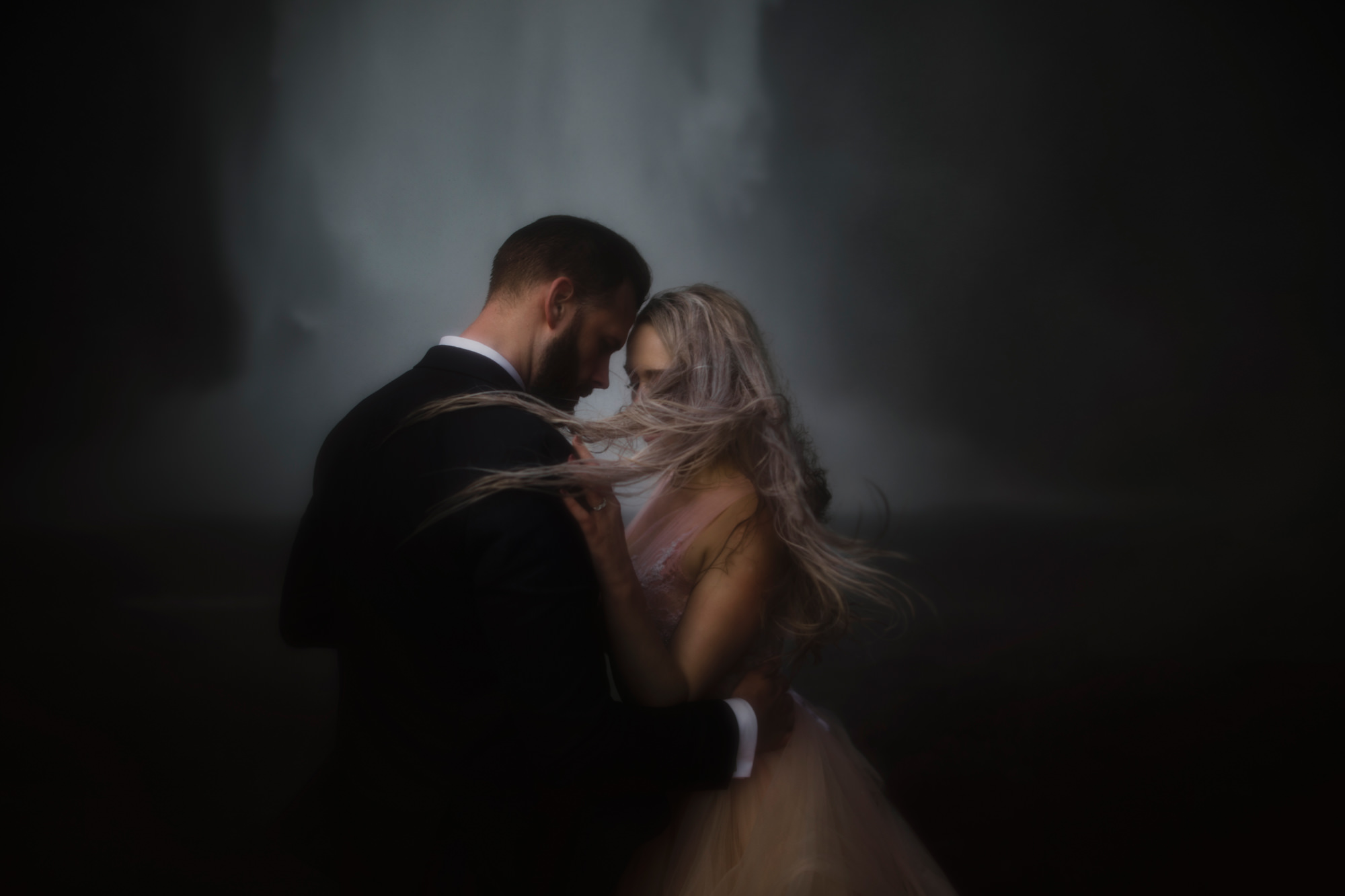 Ethereal portrait of couple at waterfall - photo by McClintock Photography Agency