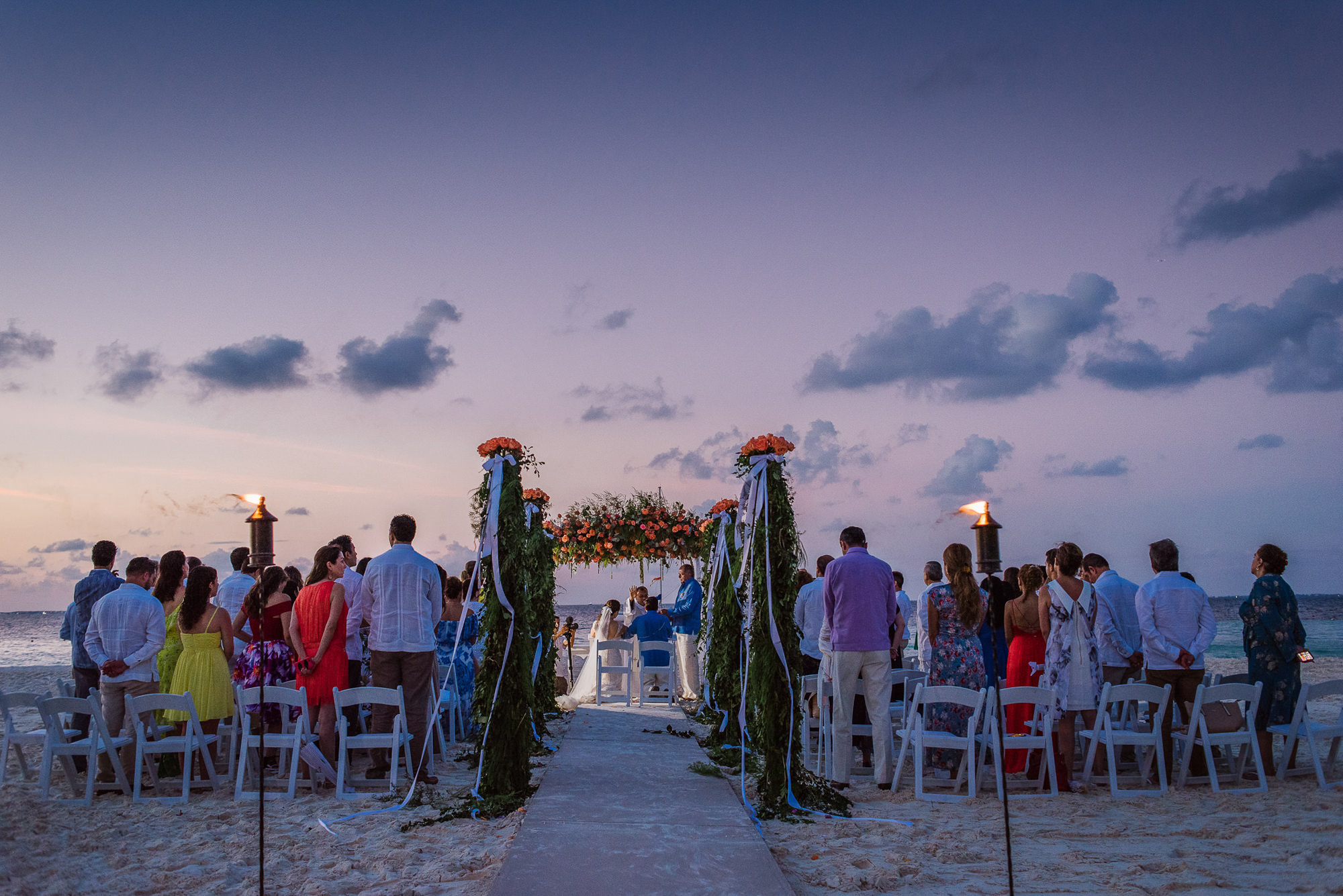 Wedding ceremony on beach at dusk, by Citlalli Rico