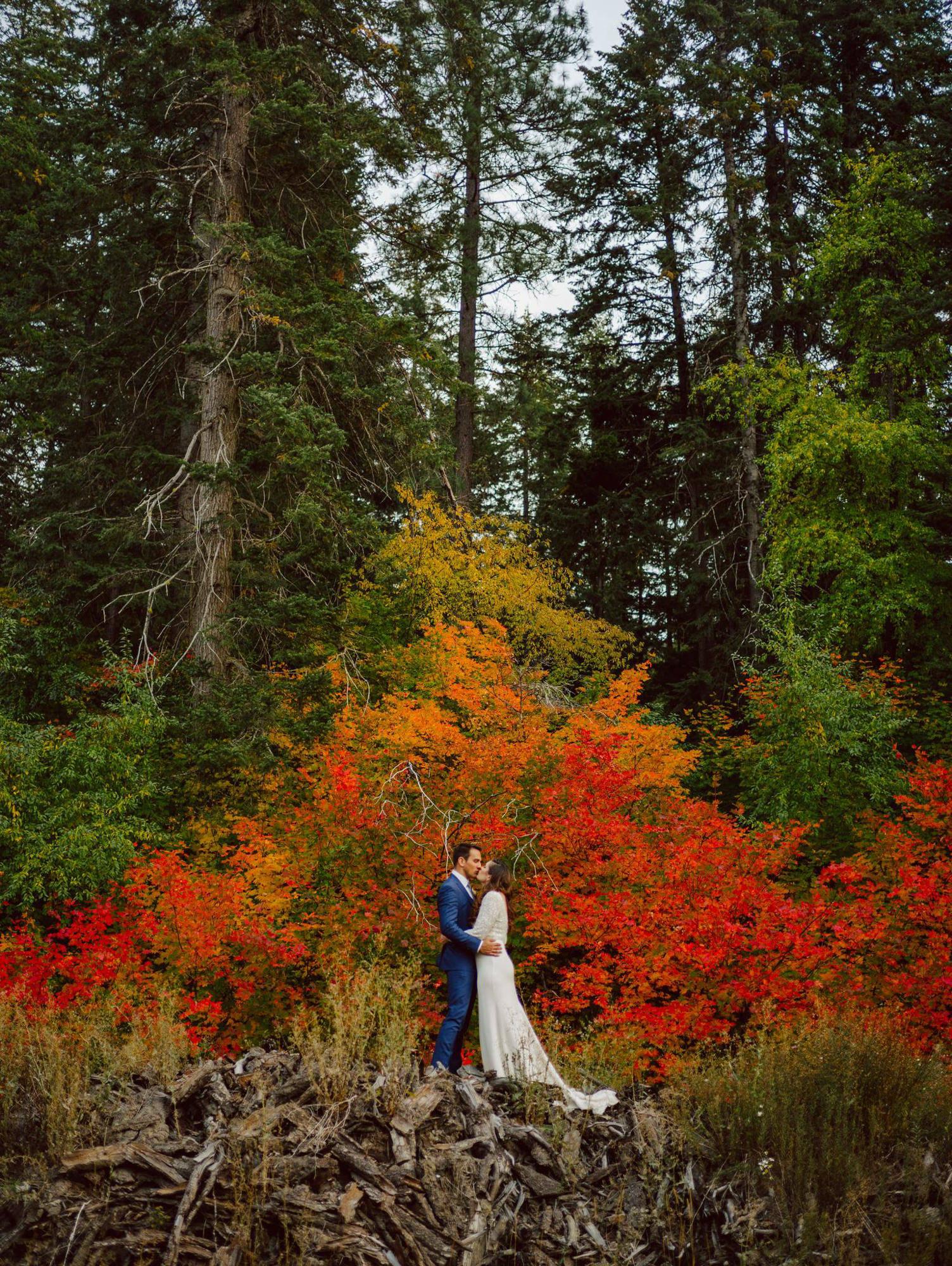 Fall wedding portrait against autumn leaves - Photo by Benj Haisch