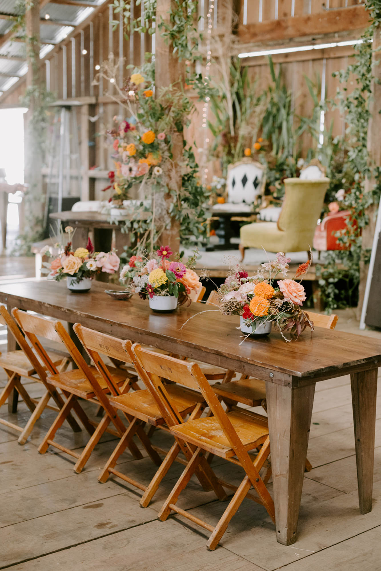 Farm table, folding chairs, fall floral  - photo by Kristen Marie Parker