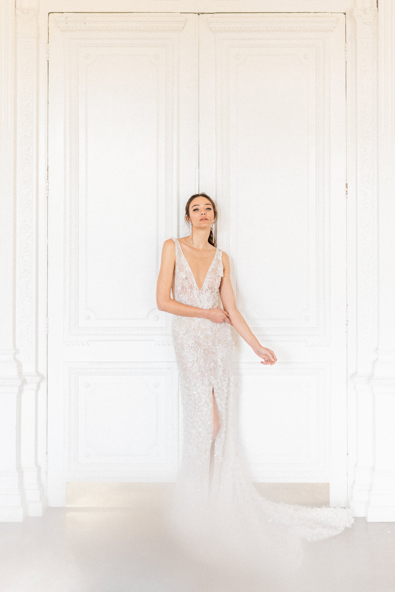 Bride wearing plunging neck lace sleeveless dress  - photo by Gianluca Adovasio Photography