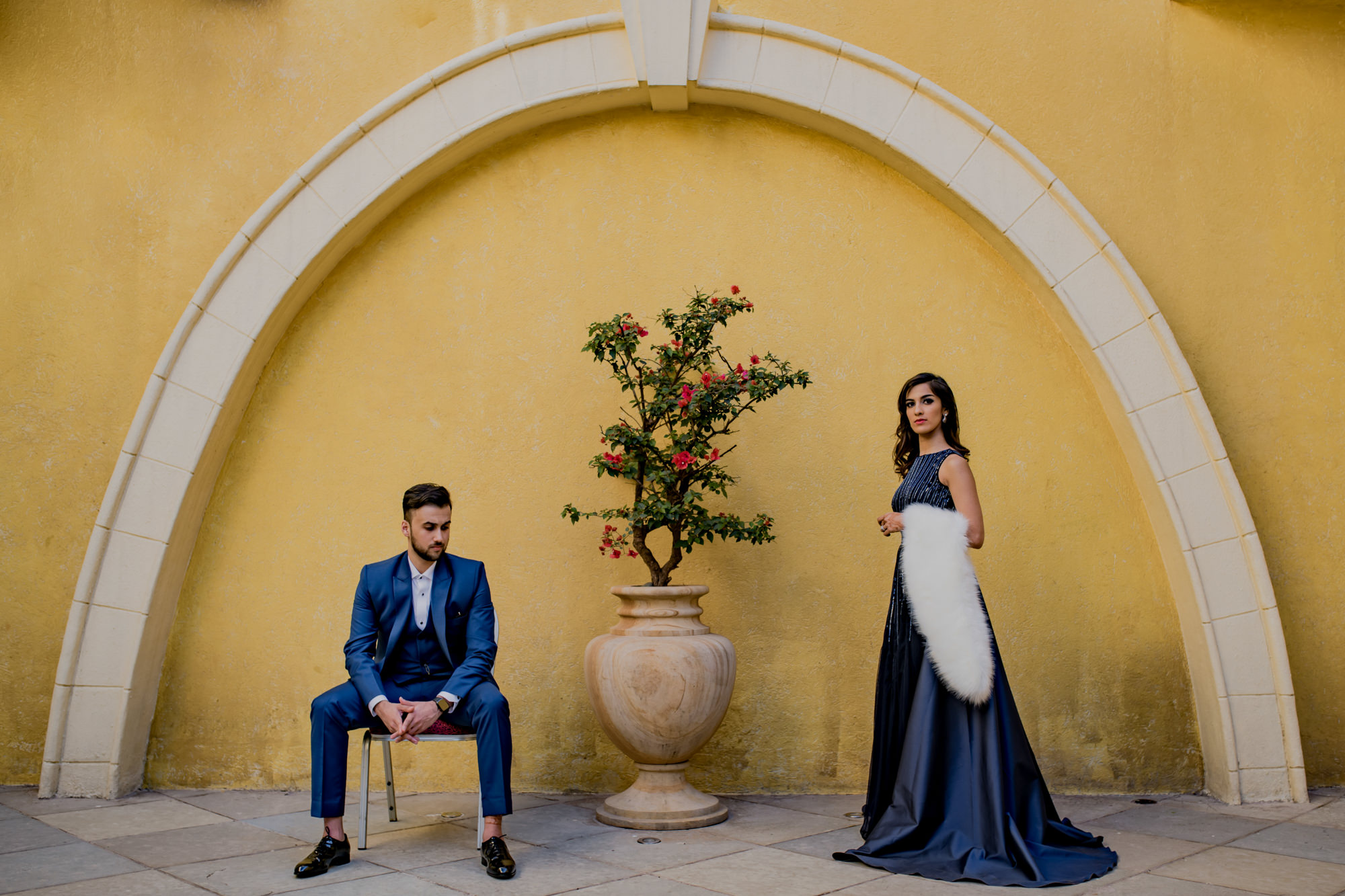 Formal fashionable couple in navy blue photo by Rimi Sen