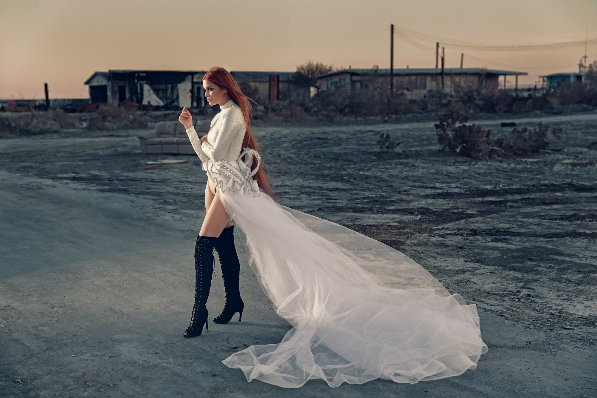 Bride in long tulle train and silver body suit  - Roberto Valenzuela Weddings