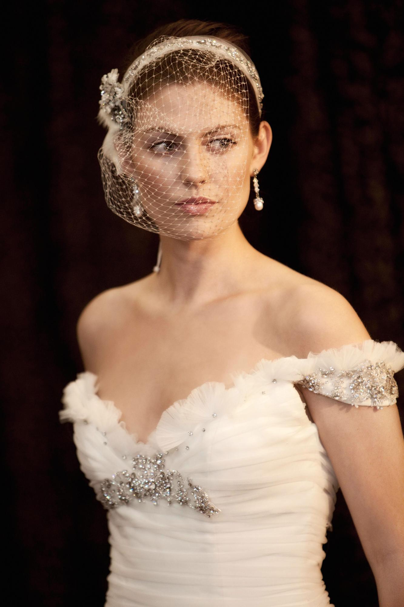 Bride in birdcage veil and feather bodice - Roberto Valenzuela Weddings