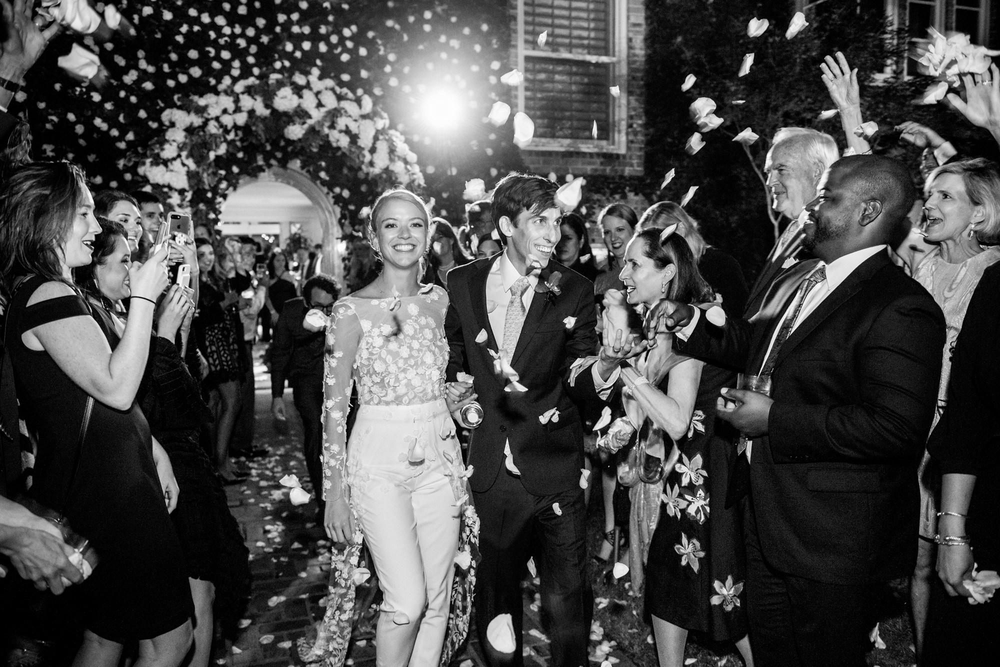 Bride and groom entrance to reception with rose petal confetti, by Morgan Lynn Razi