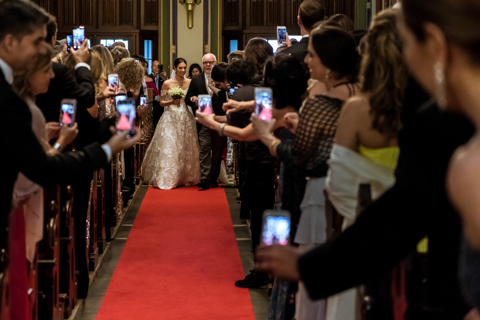 Father and bride processional surrounded by phones photo by Fotobelle: Isabelle Hattink