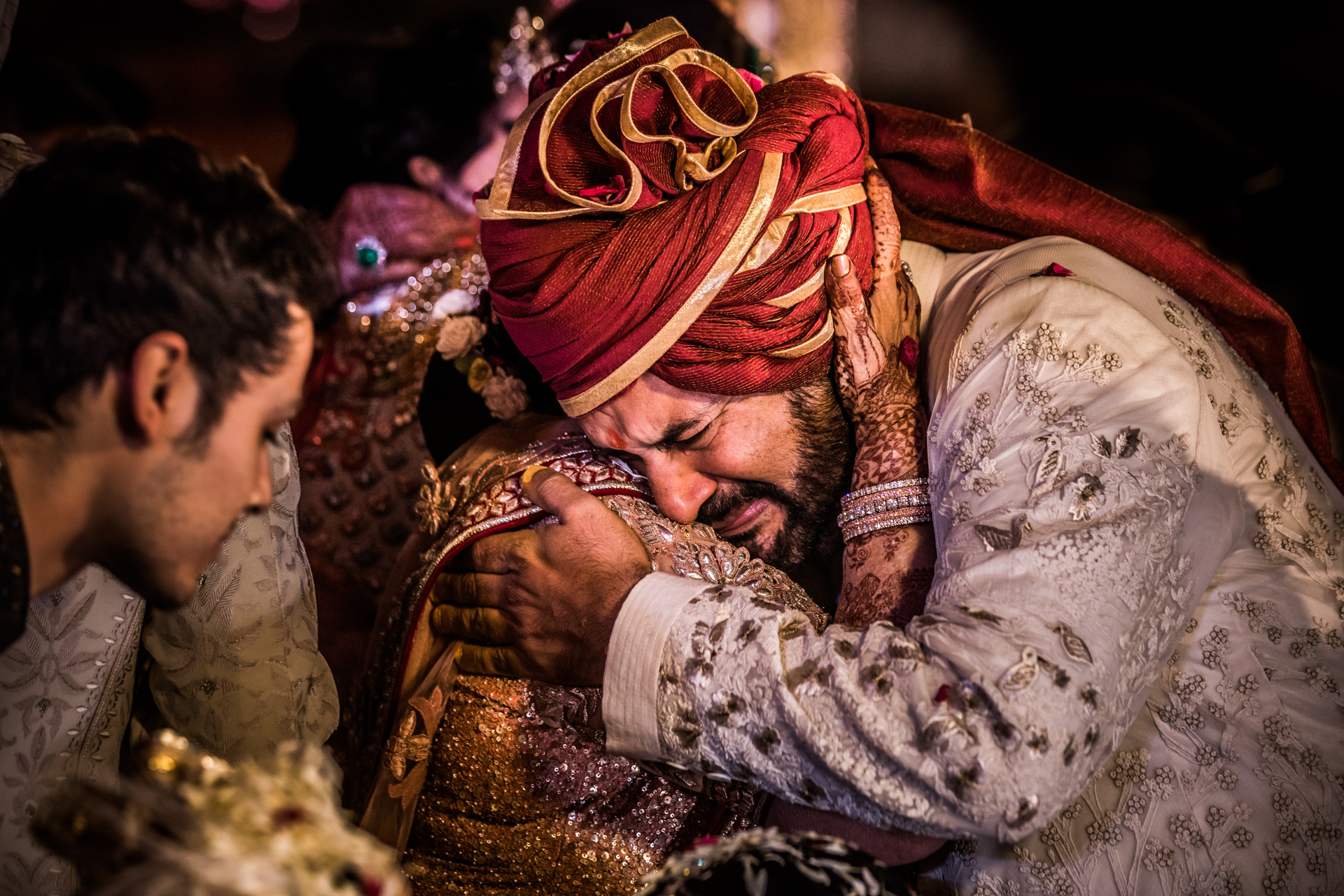Father crying on brides shoulder - photo  by Sephi Bergerson