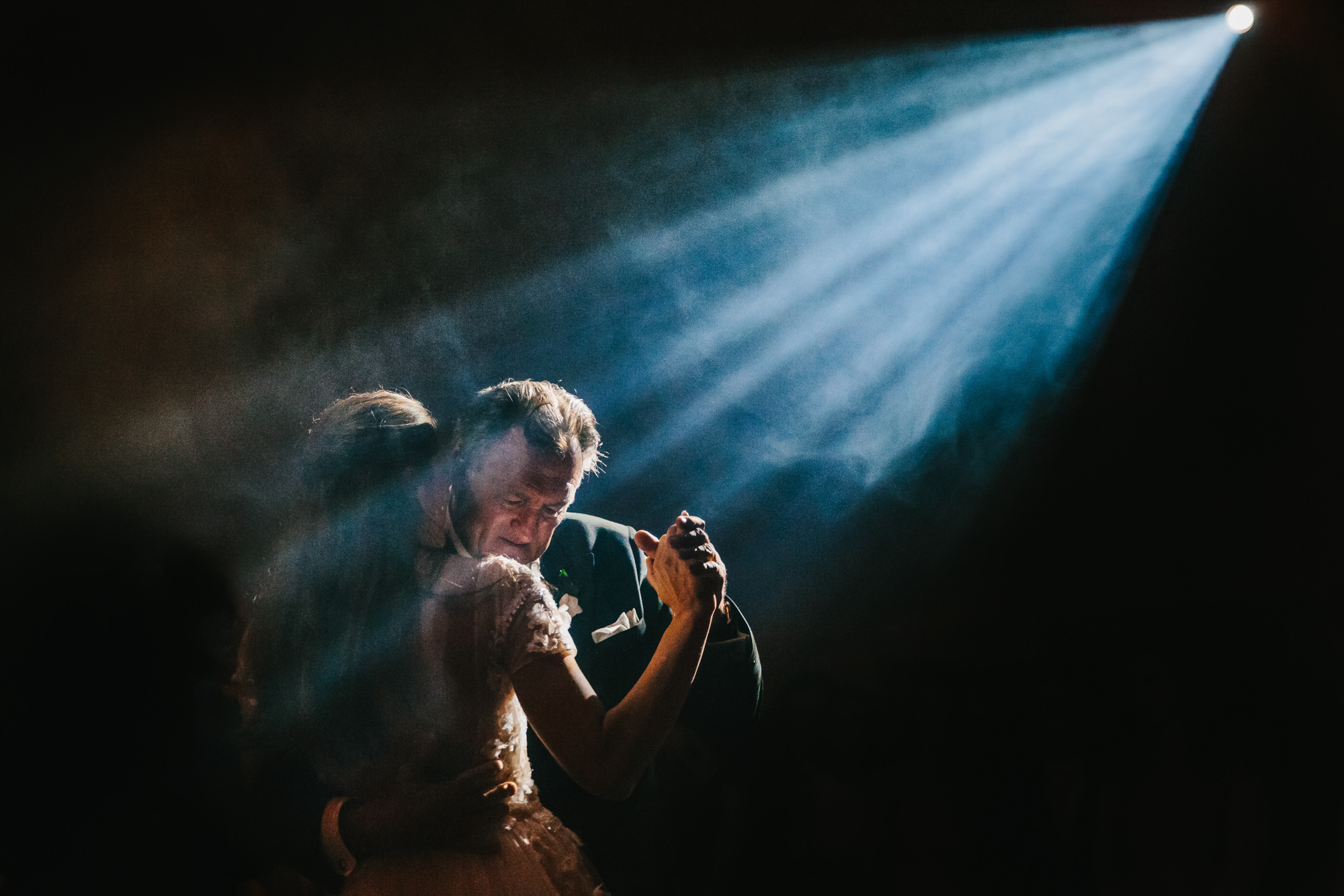 Couple dancing in spotlight photo by Yves Schepers