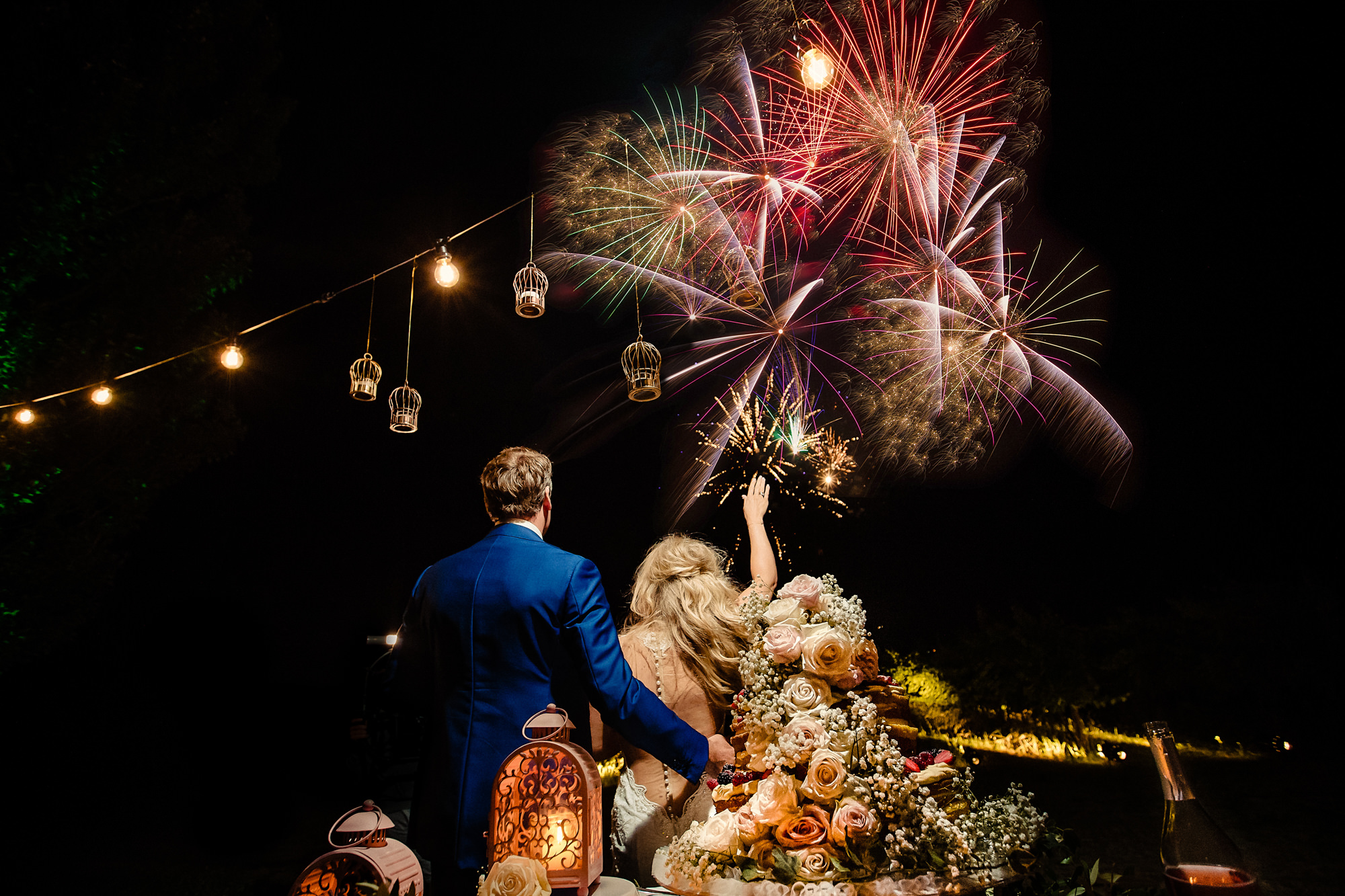 Bride and groom watching fireworks - photo by Eppel Photography