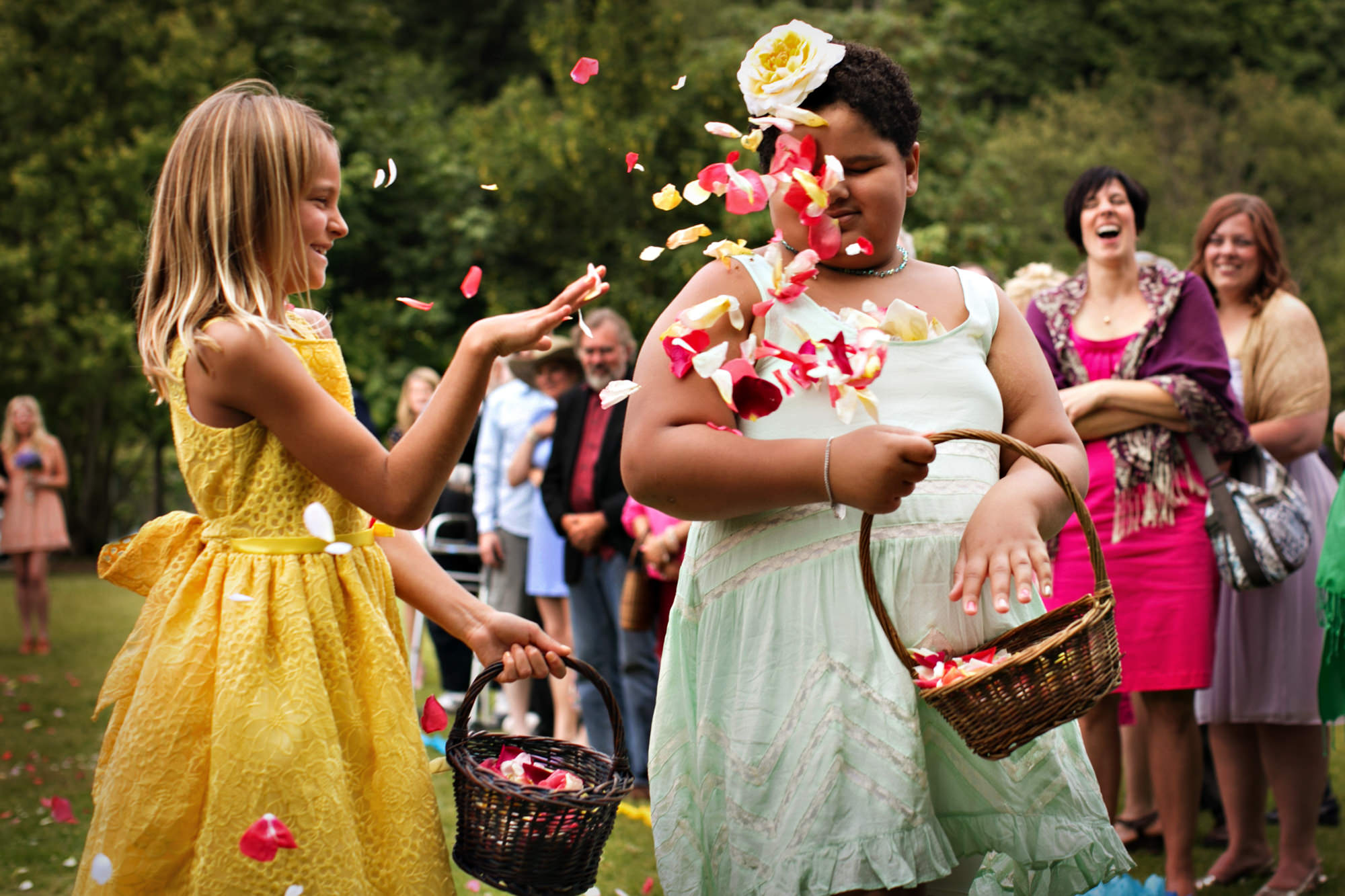 Flower girls throw rose petals at each other- PhotoJJ