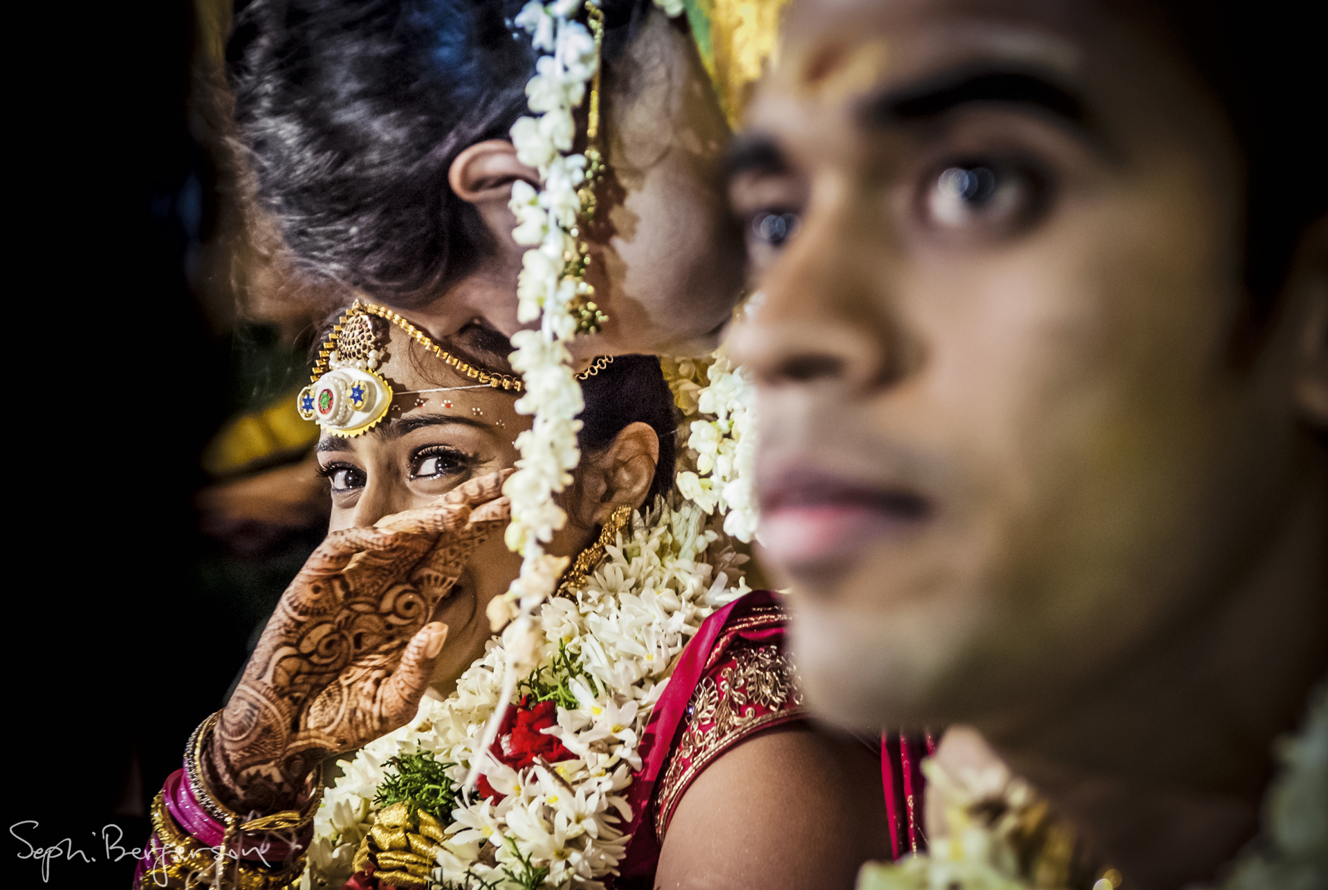 Frightened bride at Indian wedding - Photo by Sephi Bergerson